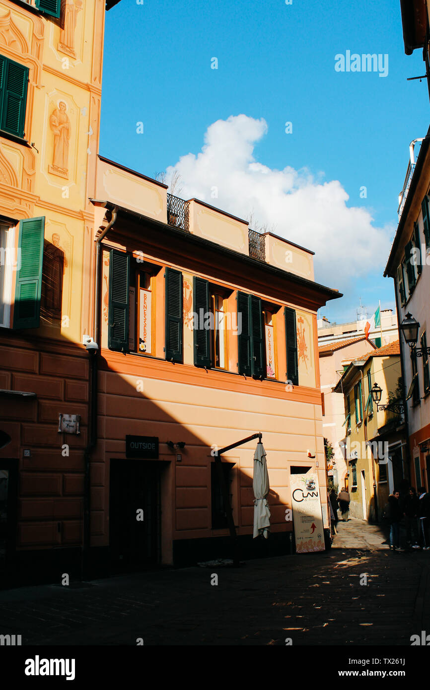 Rapallo, Italy - 03 27 2013: Houses with closed shutters on windows. View of the streets of Rapallo. - Stock Image