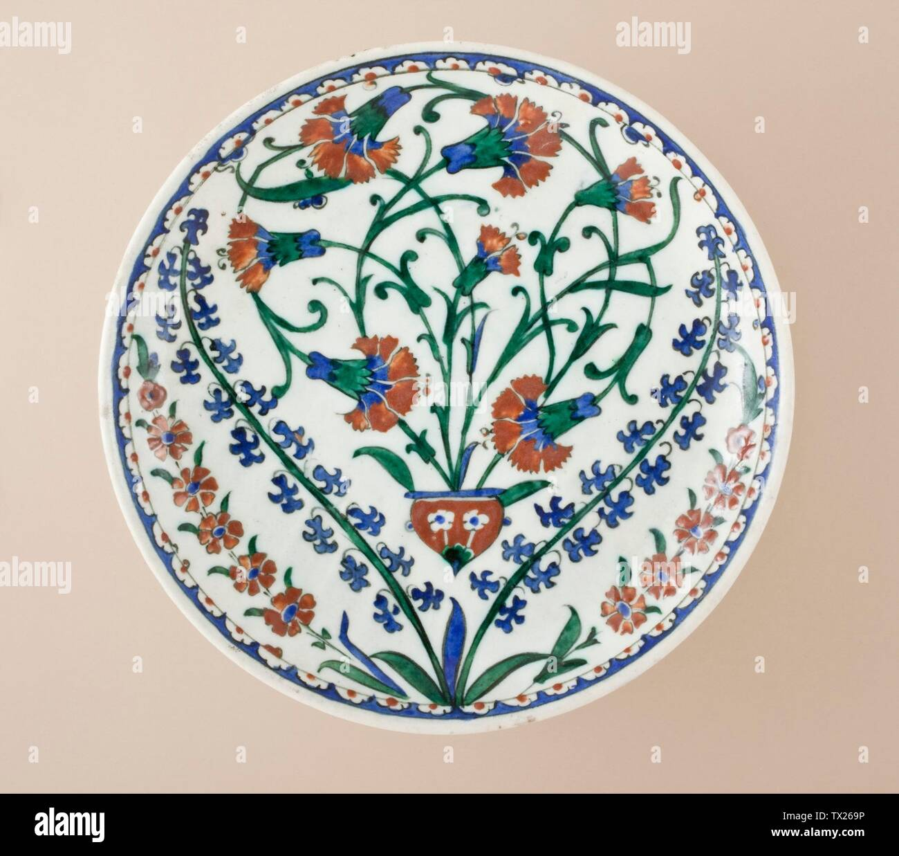 'Dish; English:  Turkey, Iznik, 1560-1585 Furnishings; Serviceware Fritware, underglaze-painted Height:  1 15/16 in. (5 cm); Diameter:  11 in. (28 cm) Purchased with funds provided by Camilla Chandler Frost (M.2006.130) Islamic Art; between 1560 and 1585 date QS:P571,+1550-00-00T00:00:00Z/7,P1319,+1560-00-00T00:00:00Z/9,P1326,+1585-00-00T00:00:00Z/9; ' - Stock Image