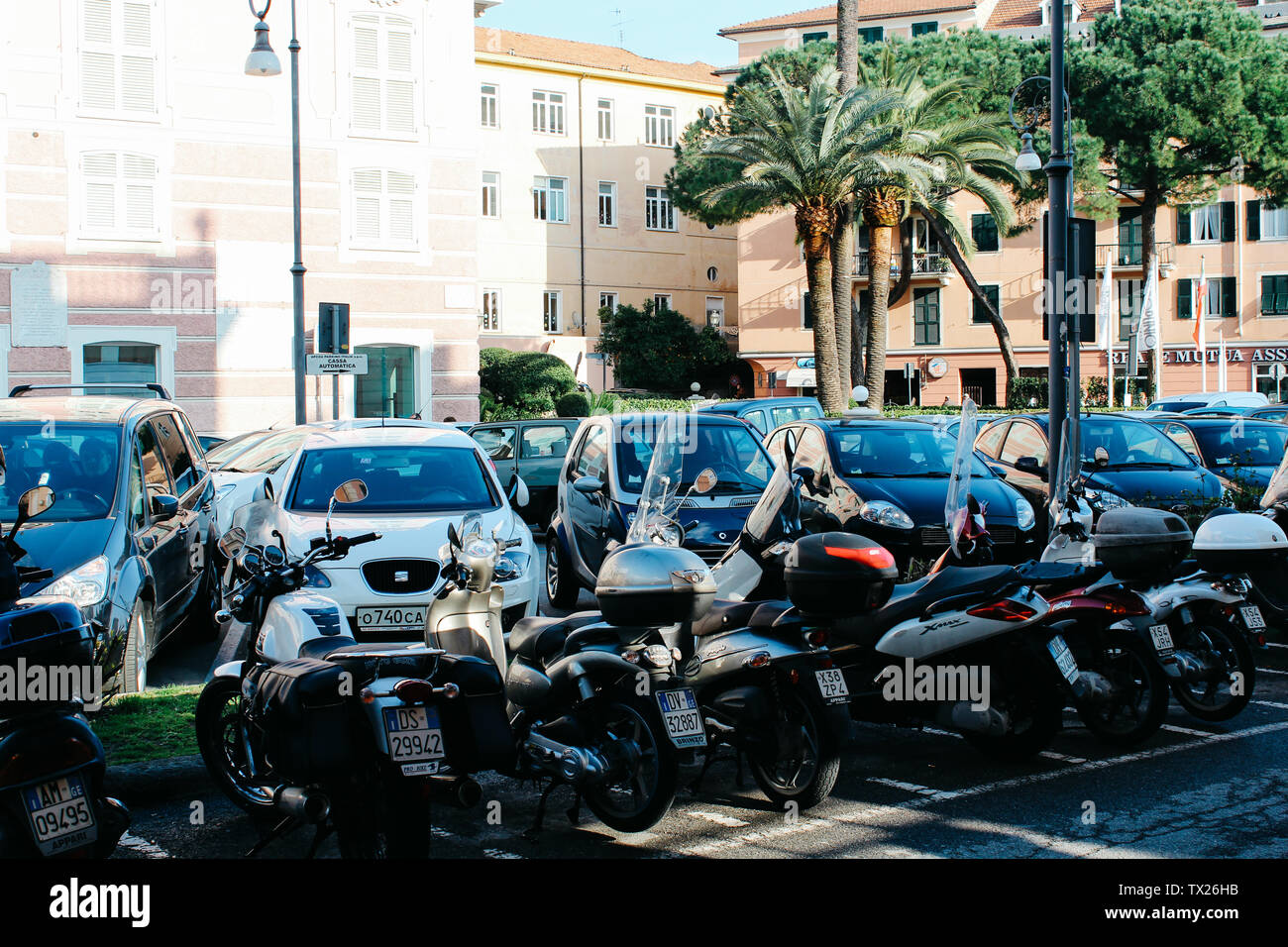 Rapallo, Italy - 03 27 2013: moped, scooters. cars on the parking. View of the streets of Rapallo - Stock Image