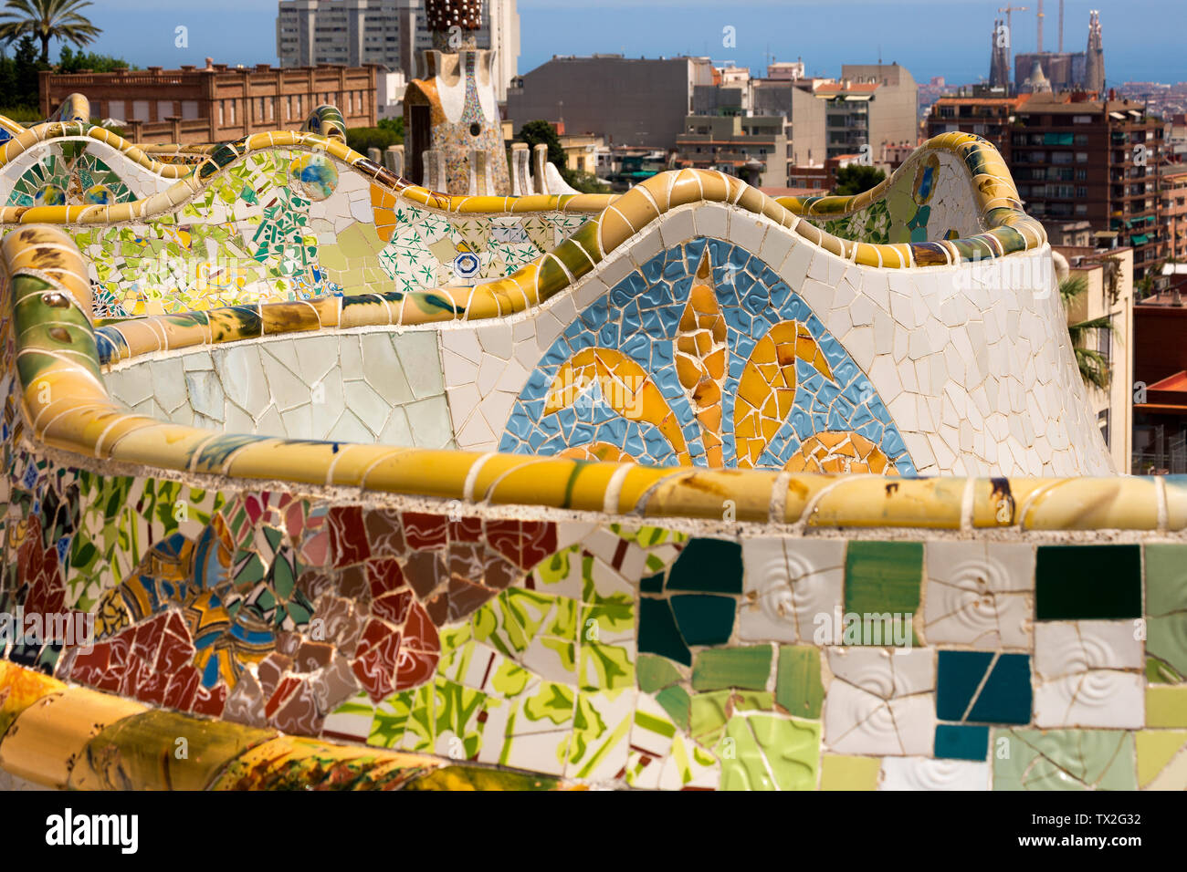 Ceramic bench and building in the Park Guell designed by the famous architect Antoni Gaudi (1852-1926). UNESCO, World Heritage Site - Stock Image