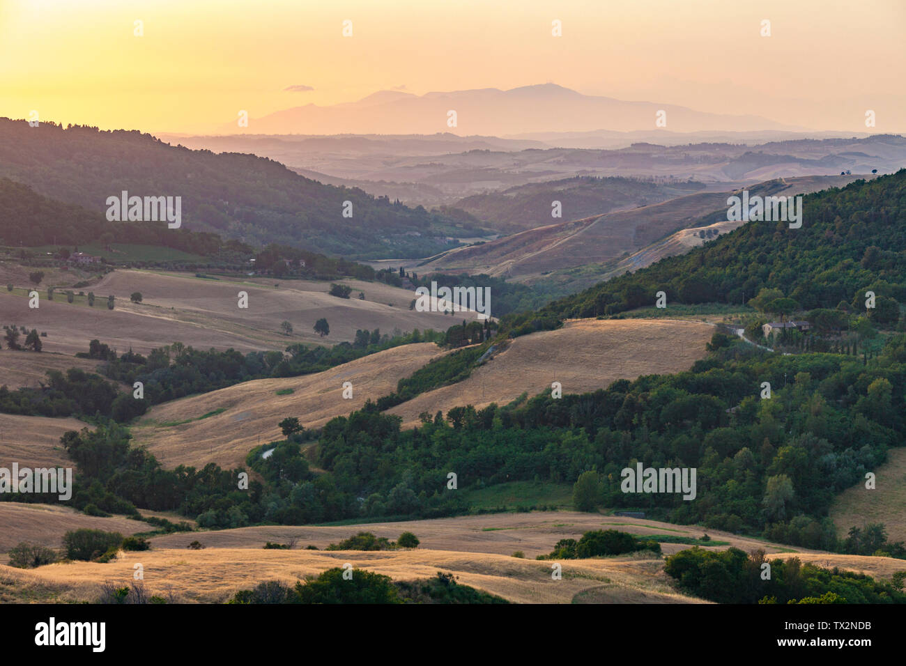 Landscape in Tuscany at sunset with hills and mountains and nice warm evening colors, Tuscany, Italy - Stock Image