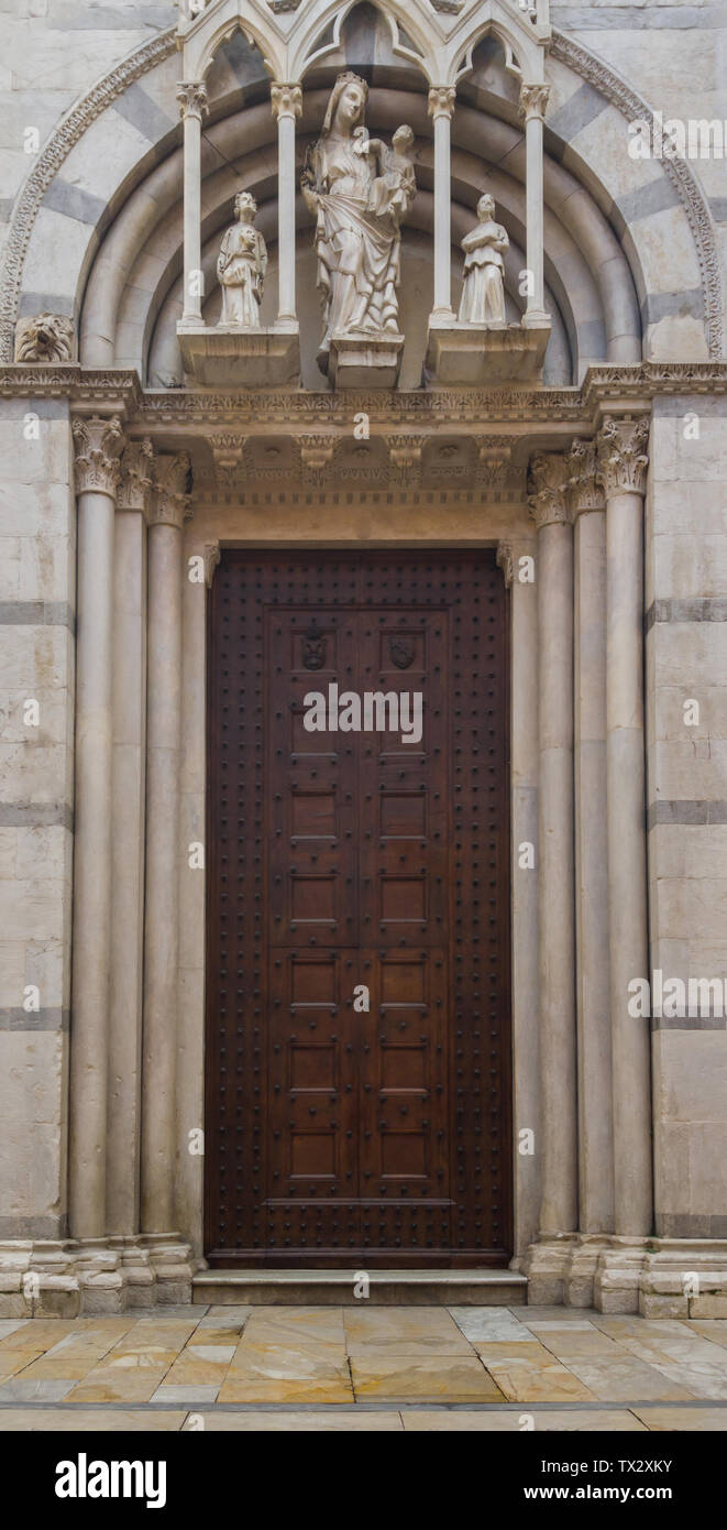 Entrance to the Catholic Christian Cathedral. Decorated gate with marble columns and sculptures. - Stock Image