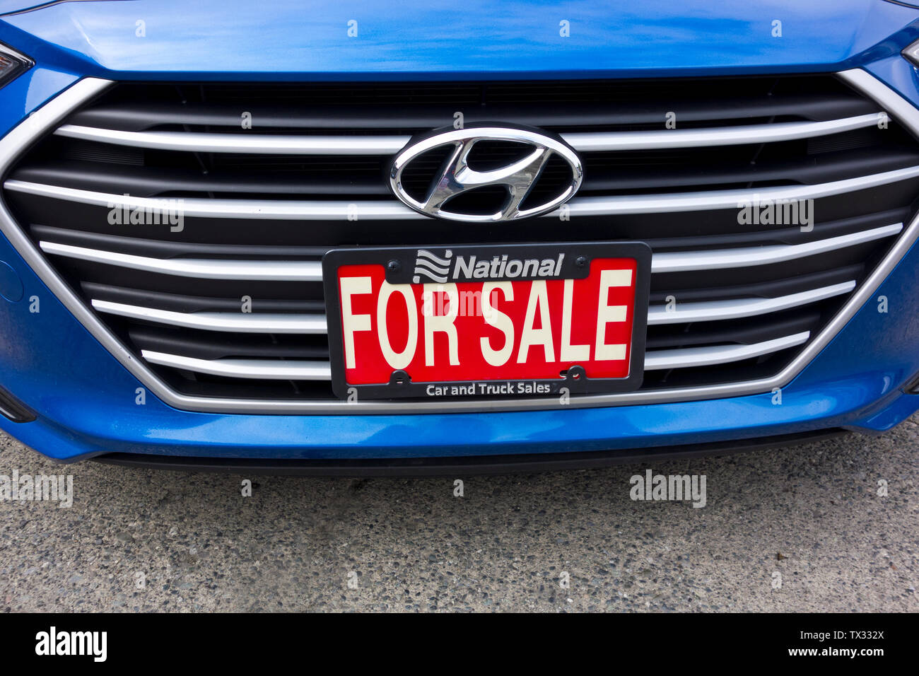 2018 Hyundai Elantra GL used car for sale.  Closeup of car grill with For Sale sign at a used car lot. - Stock Image