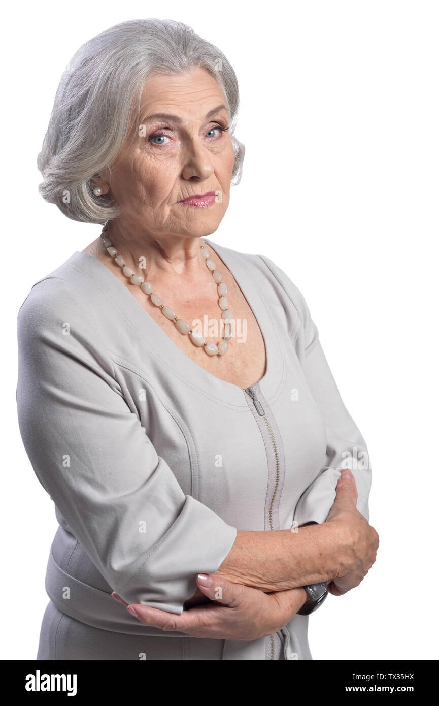 Sad senior woman posing isolated on white background - Stock Image