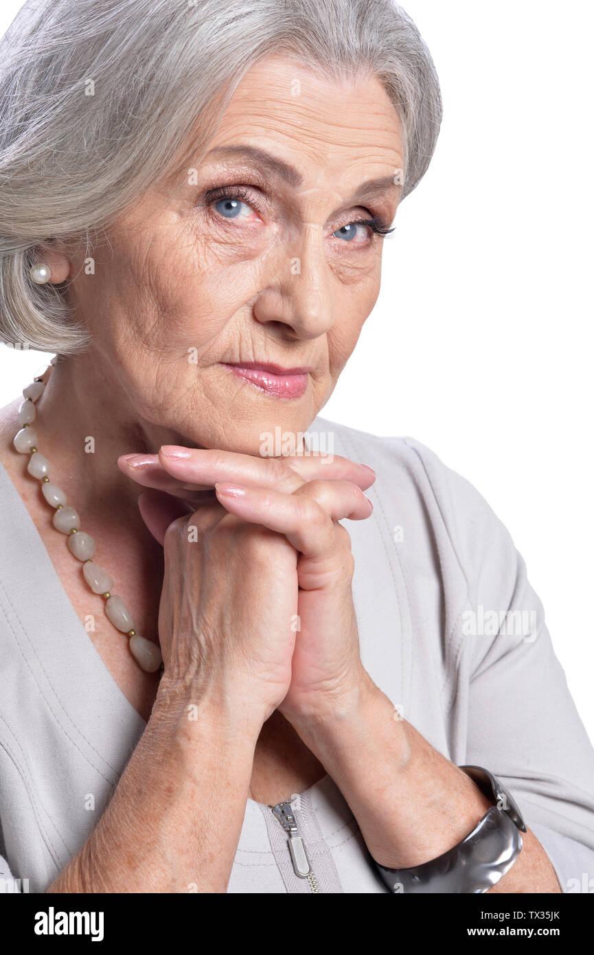Happy senior woman posing isolated on white background - Stock Image