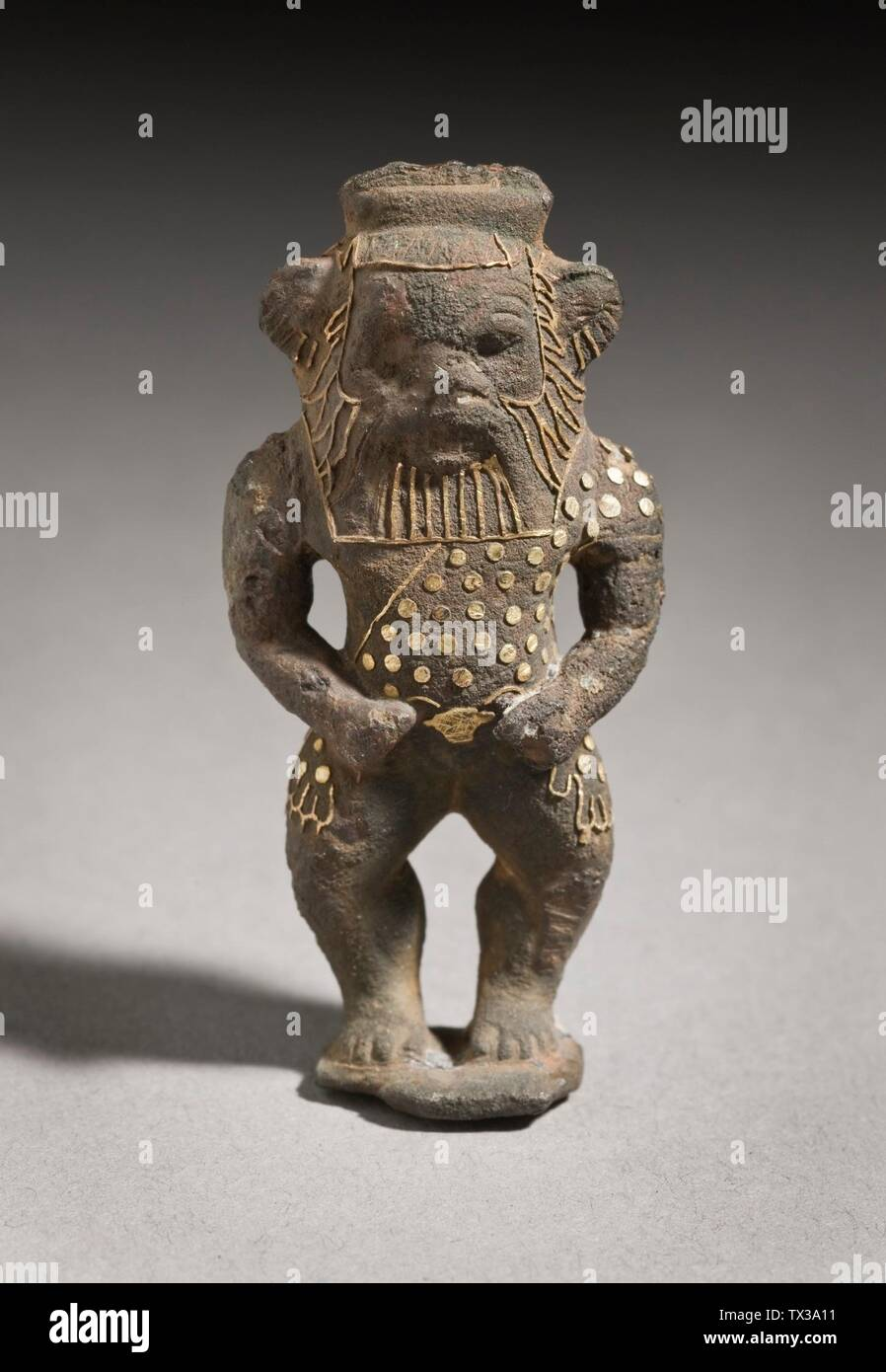 'Figurine of the God Bes; Egypt, Third Intermediate Period (1081 - 711 B.C.) Sculpture Bronze with gold inlays Height:  2 1/4 in. (5.7 cm) Museum Associates General Acquisition Fund, Joan Palevsky, and the Ancient Art Council (M.90.28) Egyptian Art; Third Intermediate Period (1081 - 711 B.C.); ' - Stock Image