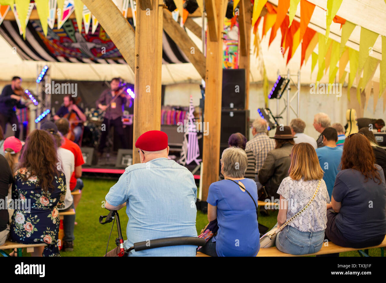CPeople watch a folk band play during day two of the Tafwyl festival at Cardiff Castle. Stock Photo