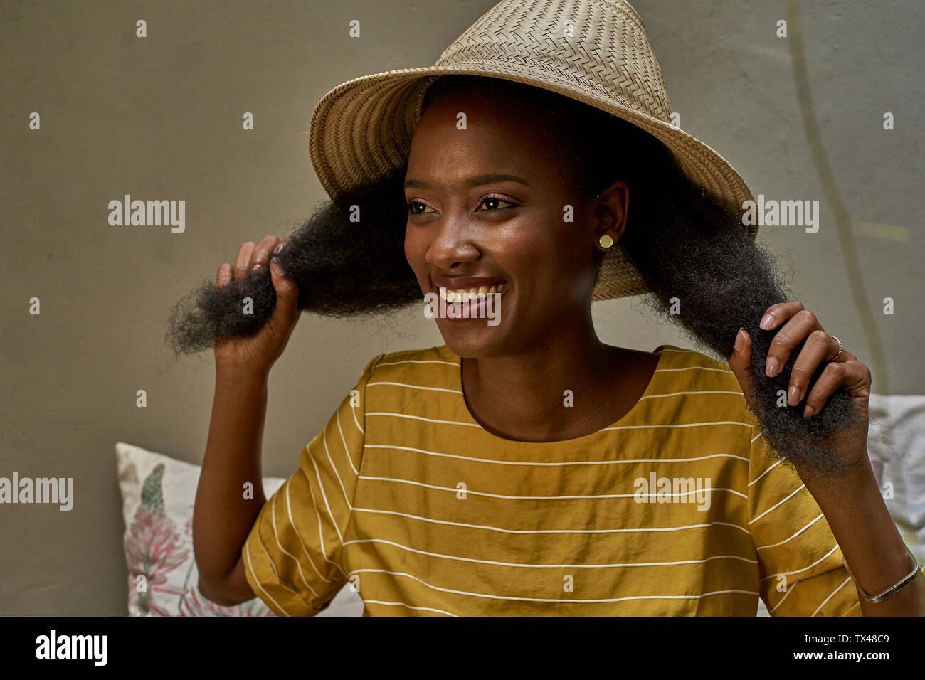 Portrait of happy longhaired woman wearing a traditional hat Stock Photo