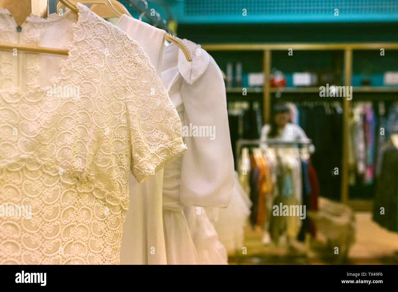 Vintage boutique with woman in background Stock Photo