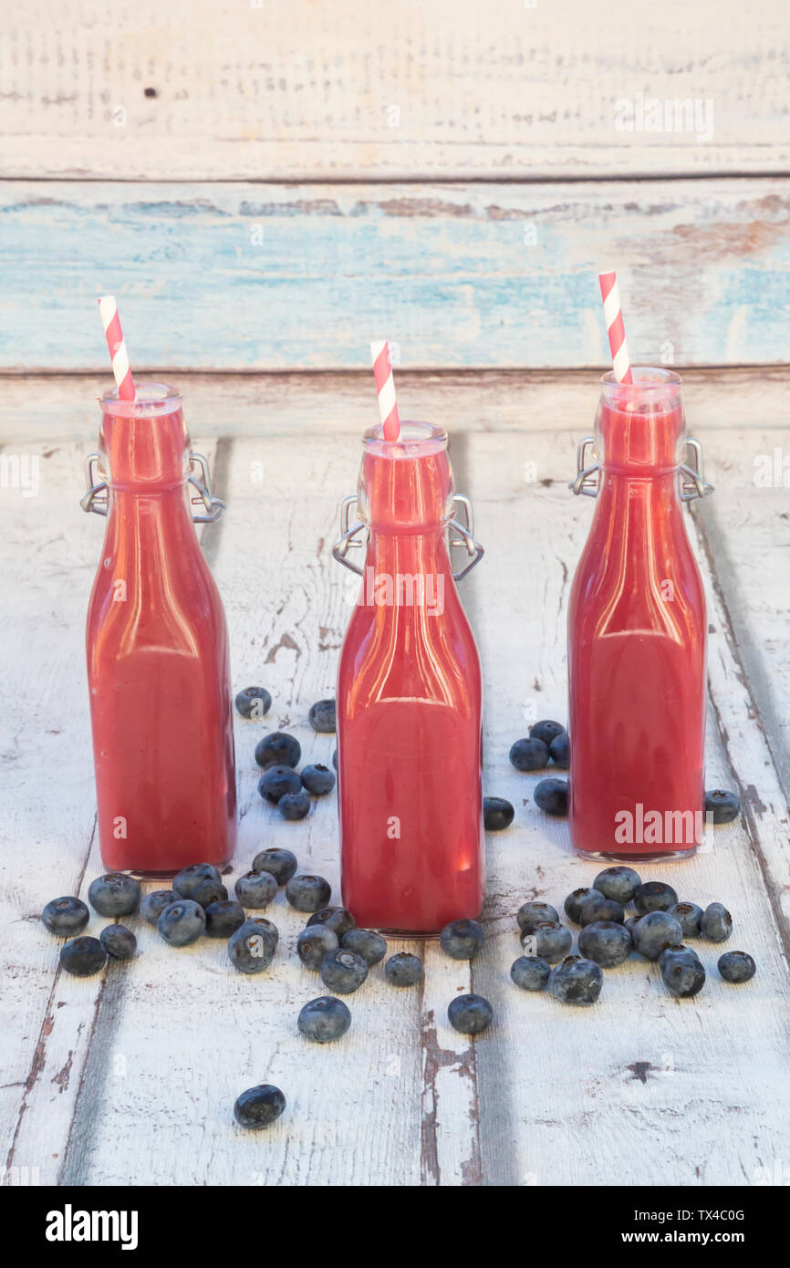 Blueberry smoothie in bottles - Stock Image