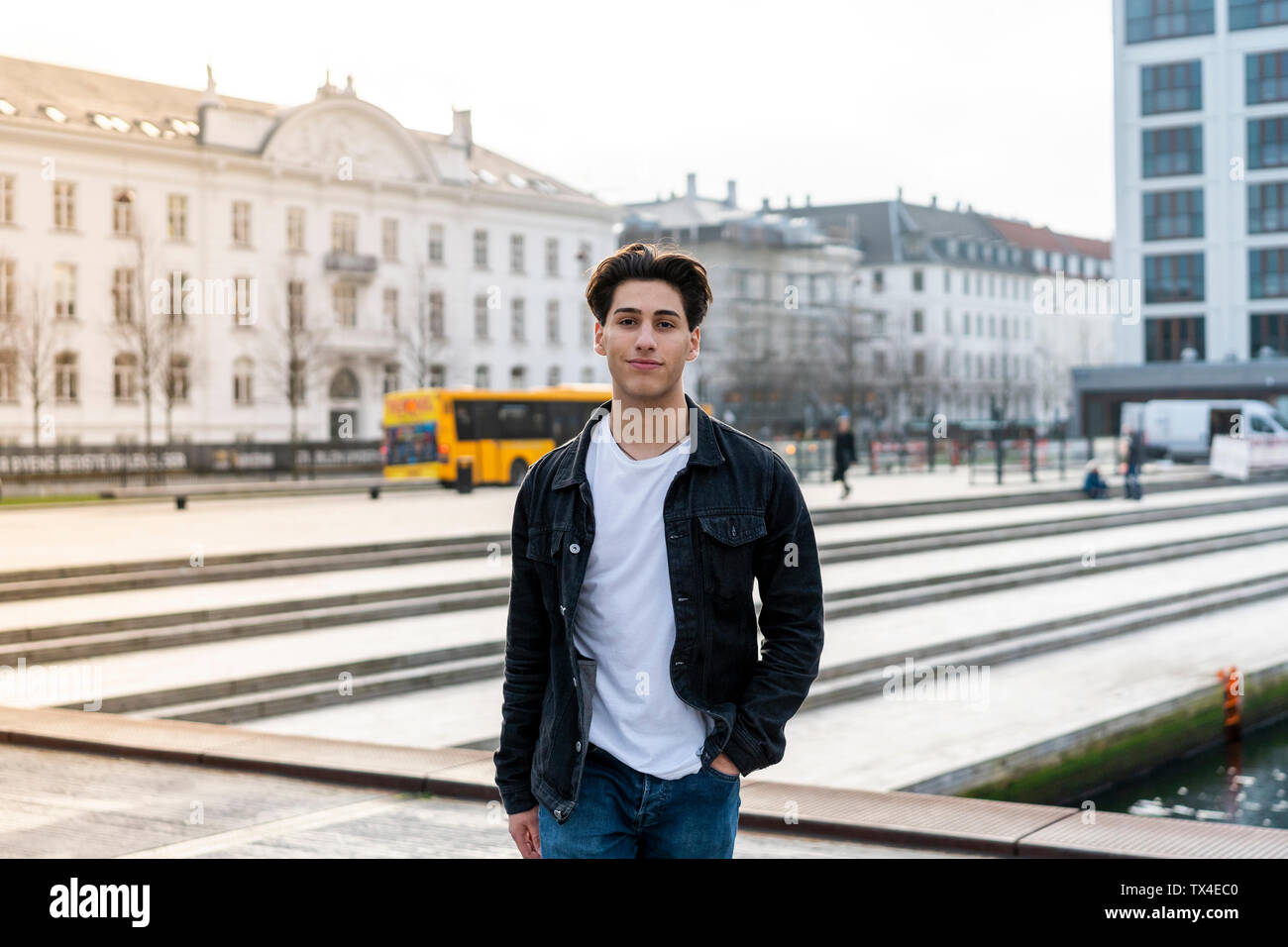 Denmark, Copenhagen, portrait of a confident young man in the city - Stock Image