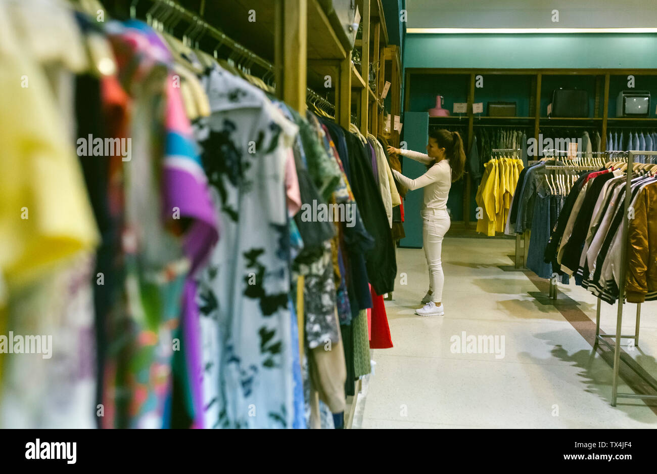 Woman shopping for clothes in a vintage boutique Stock Photo