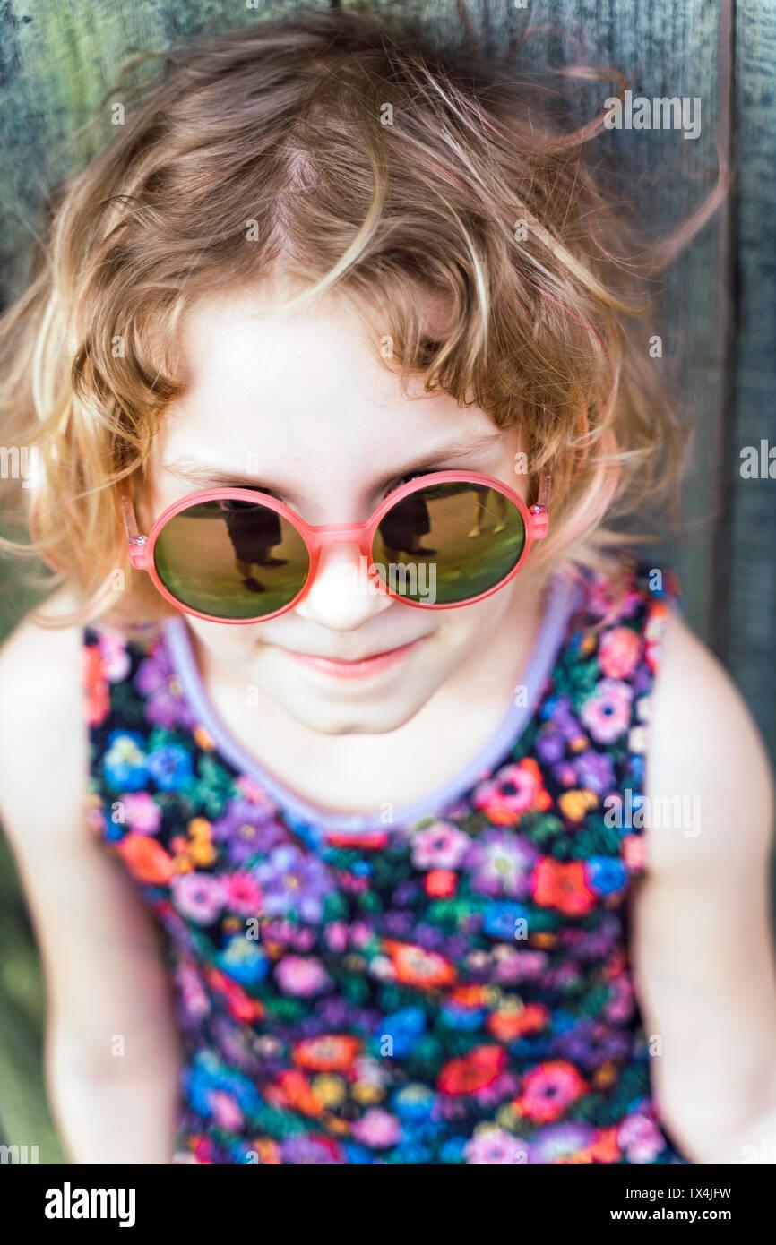 Portrait of little girl wearing sunglasses Stock Photo
