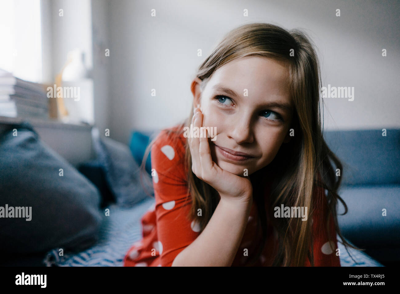 Girl at home resting her head in hand Stock Photo