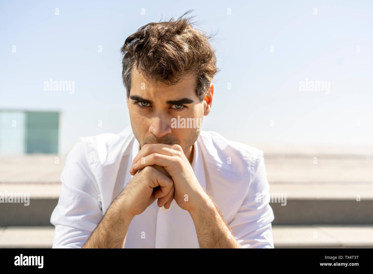 Portrait of serious businessman outdoors - Stock Image