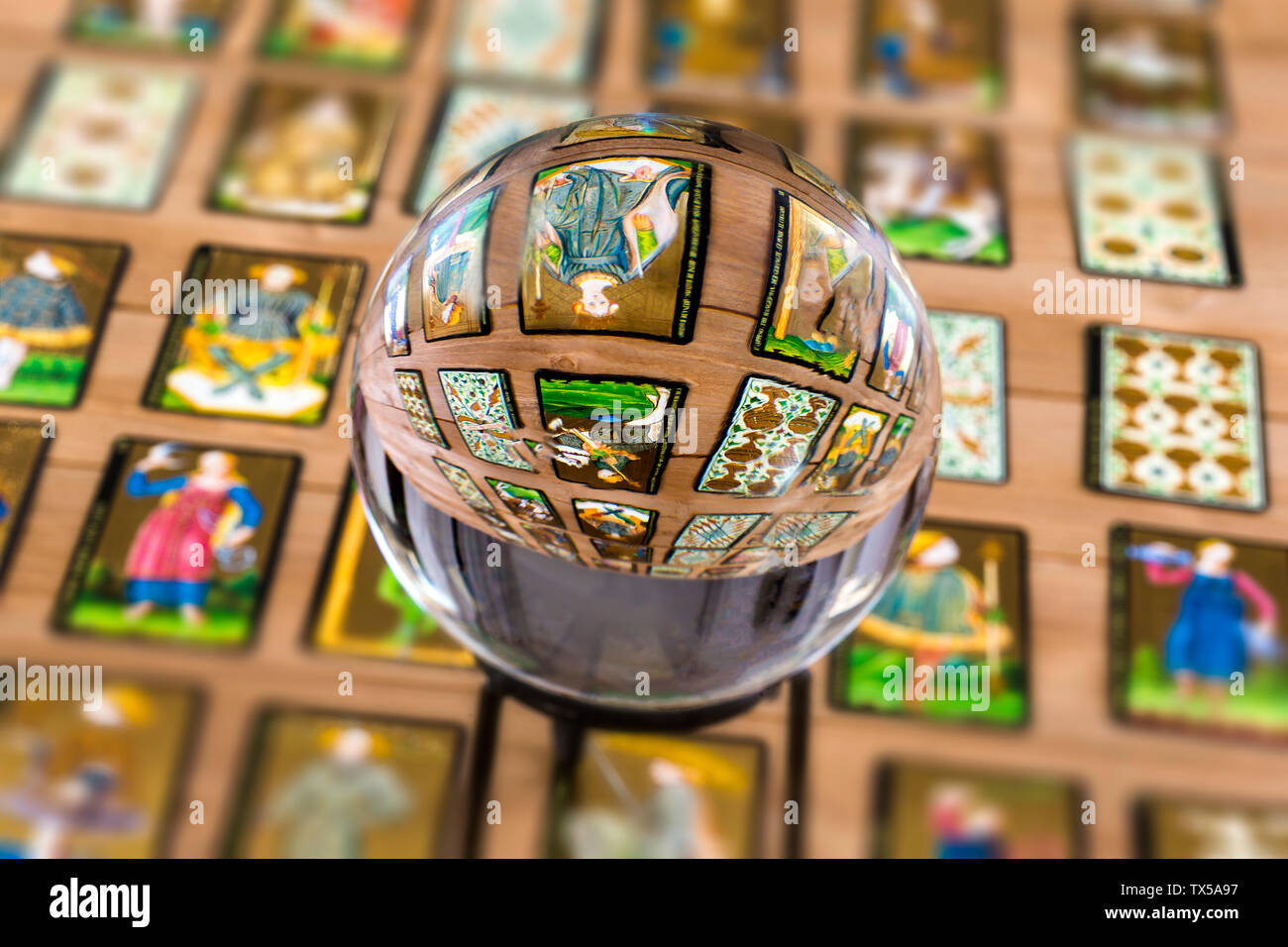 Fortune teller Crystal ball and in transparency tarot cards background . - Stock Image