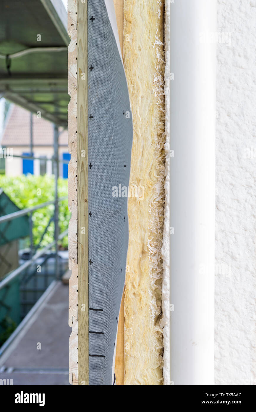 Side view house and insulation detail. Building insulation exterior, added to buildings for comfort and energy efficiency Stock Photo