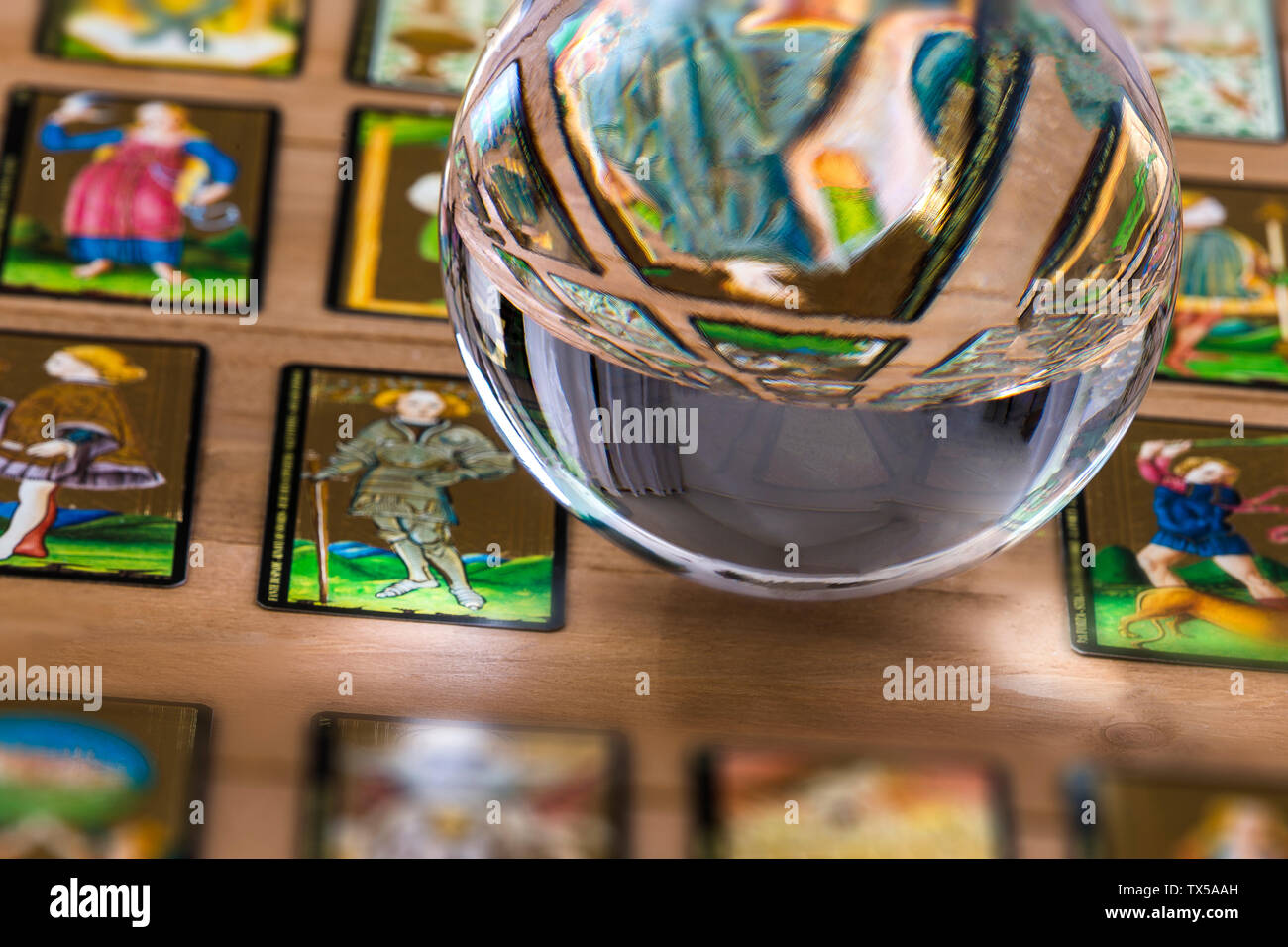 Fortune teller Crystal ball and in transparency tarot cards