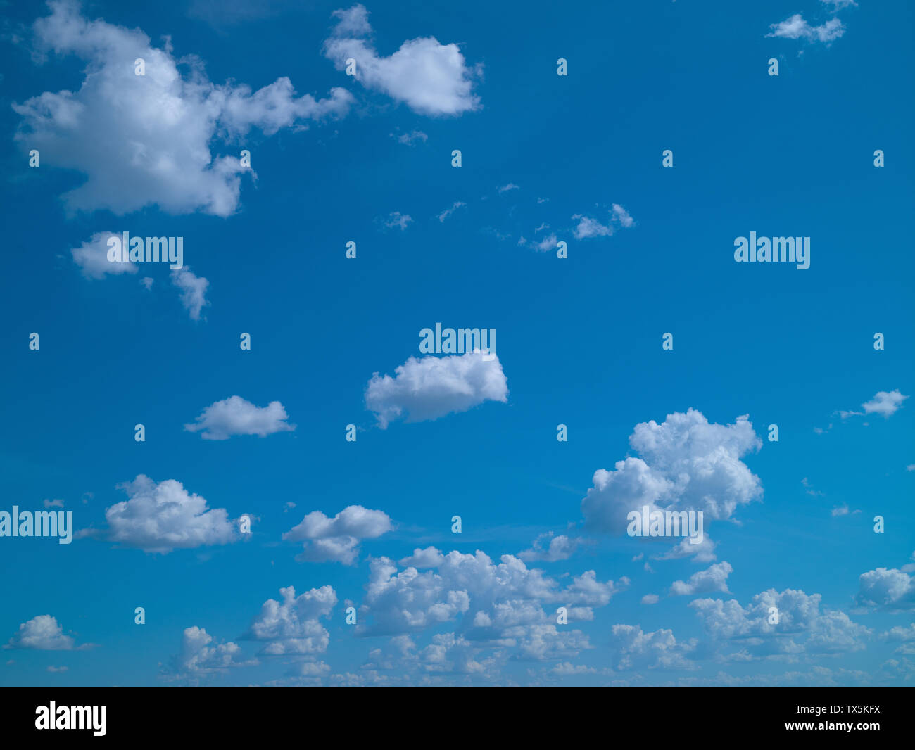 Blue sky with white cumulus clouds, sunny day, summer - Stock Image