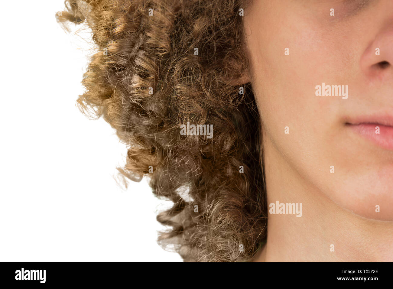 splited in half cropped portrait of a young curly European man with long curly hair and closed eyes close up. very lush male hair. curling hair men's. Stock Photo
