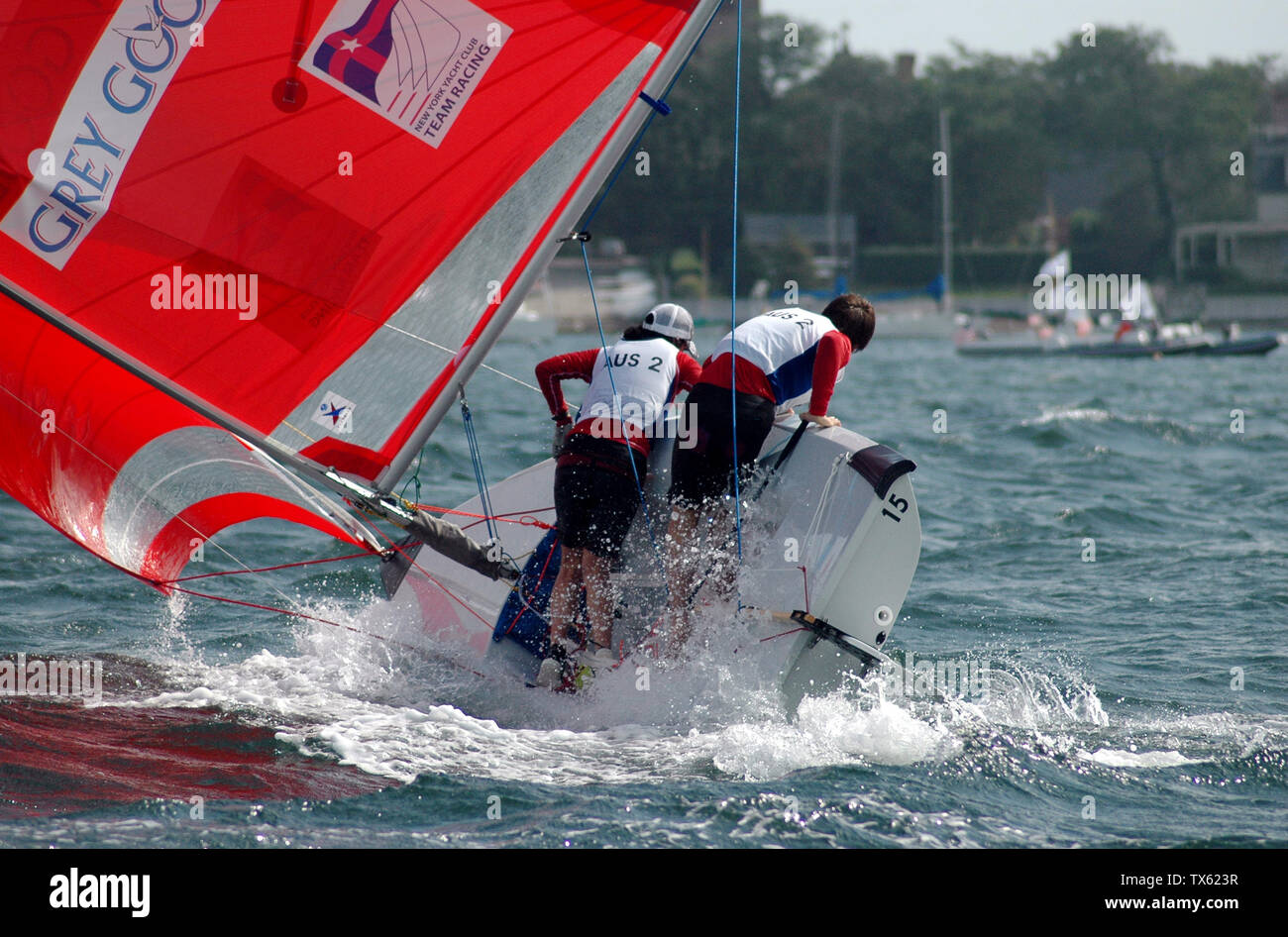 """English: A team at the 2005 ISAF Team Racing World Championship narrowly avoids capsizing. Deutsch: Die Crew einer Segeljolle bei den ISAF Team Racing World Championship 2005 kämpft gegen die drohende Kenterung.Weitere Informationen, es handelt sich um eine Vanguard 15 Jolle (Bilder der Klasse / Ankündigung der ISAF ), das Team Australia 2 (AUS 2) beendete die Meisterschaften an 13. Position ([1]) und hat die Situation letztlich doch noch gemeistert [2].; 26 September 2005; Original photo by Cathy Giacomini:  Original photo, edited by User:Btr; Cathy Giacomini (original photo), edited by User Stock Photo"