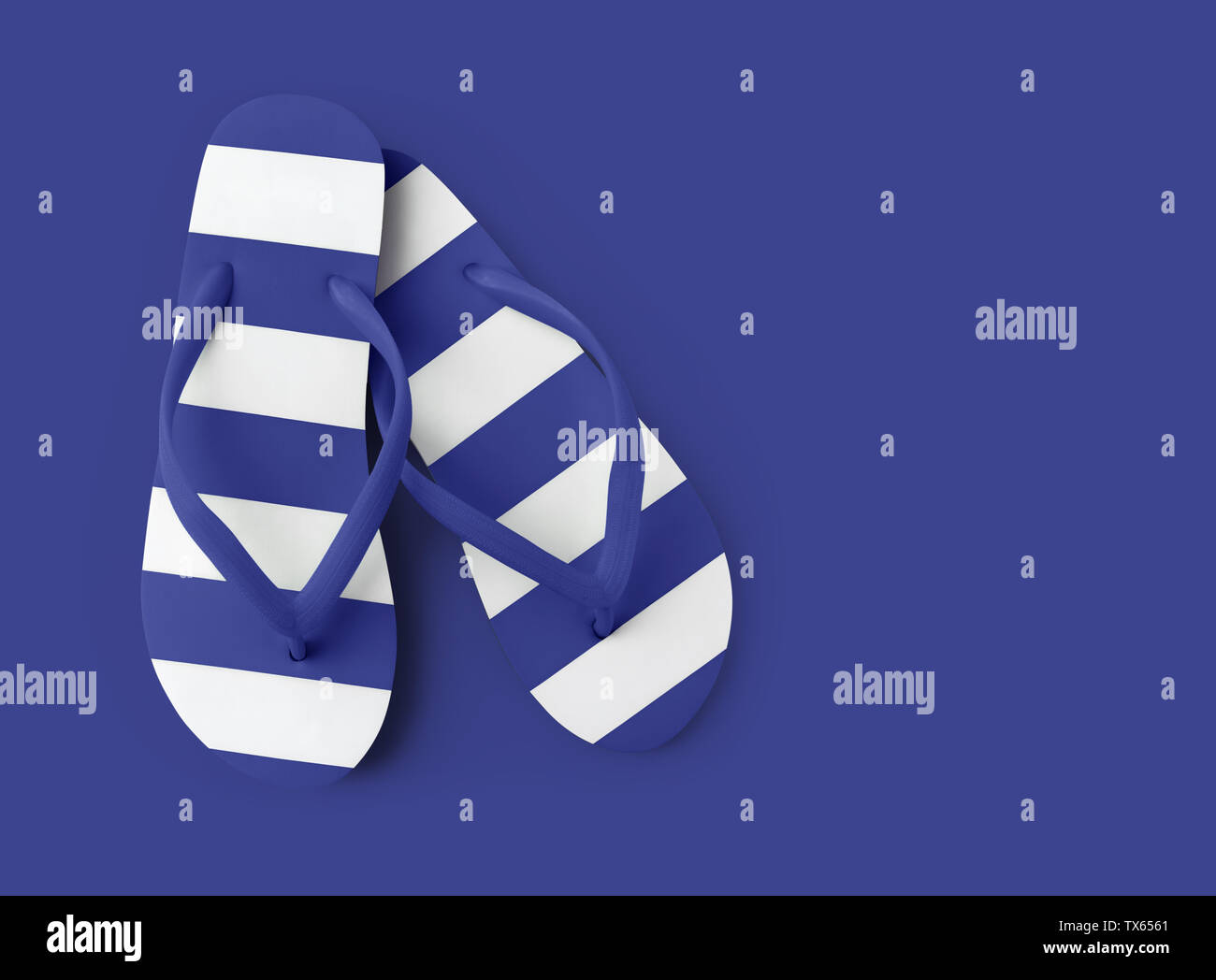 Top view of summer beach blue flip flop isolated on blue background sea holiday vacation and travel concept - Stock Image