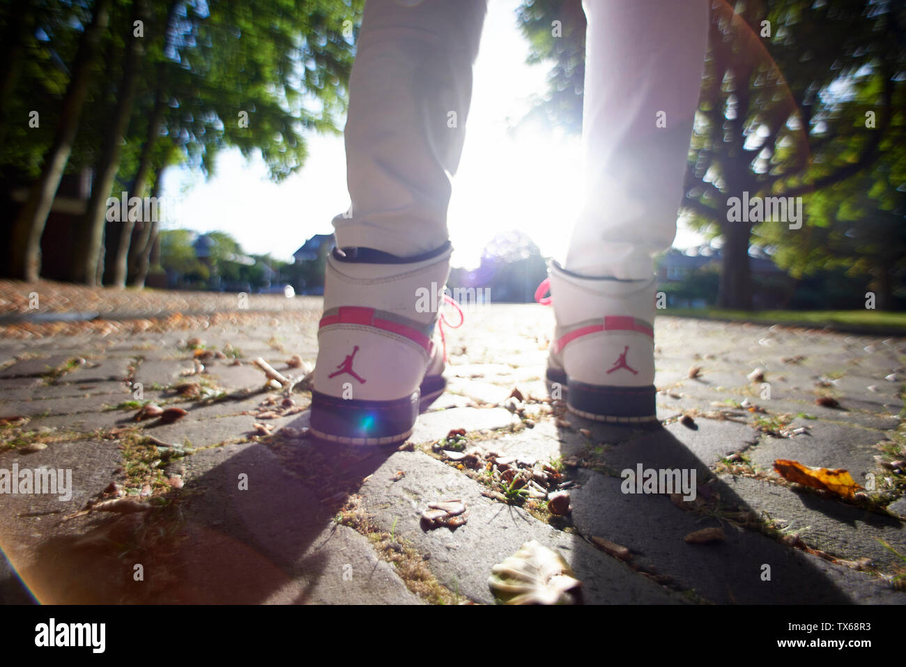 brand new c7fa6 0d3f1 Low angle close up of a woman wearing Nike Air Jordan's in ...