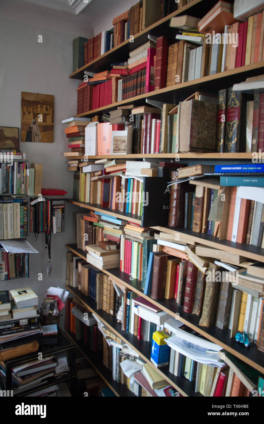 Paris, France - July 04, 2018: Home library with a huge number of books in a small apartment in the suburbs of Paris - Stock Image