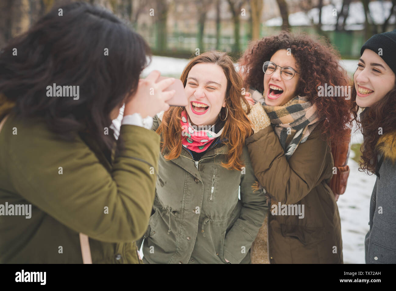 group of girlfriends having fun in winter day – togetherness, holiday, happiness - Stock Image