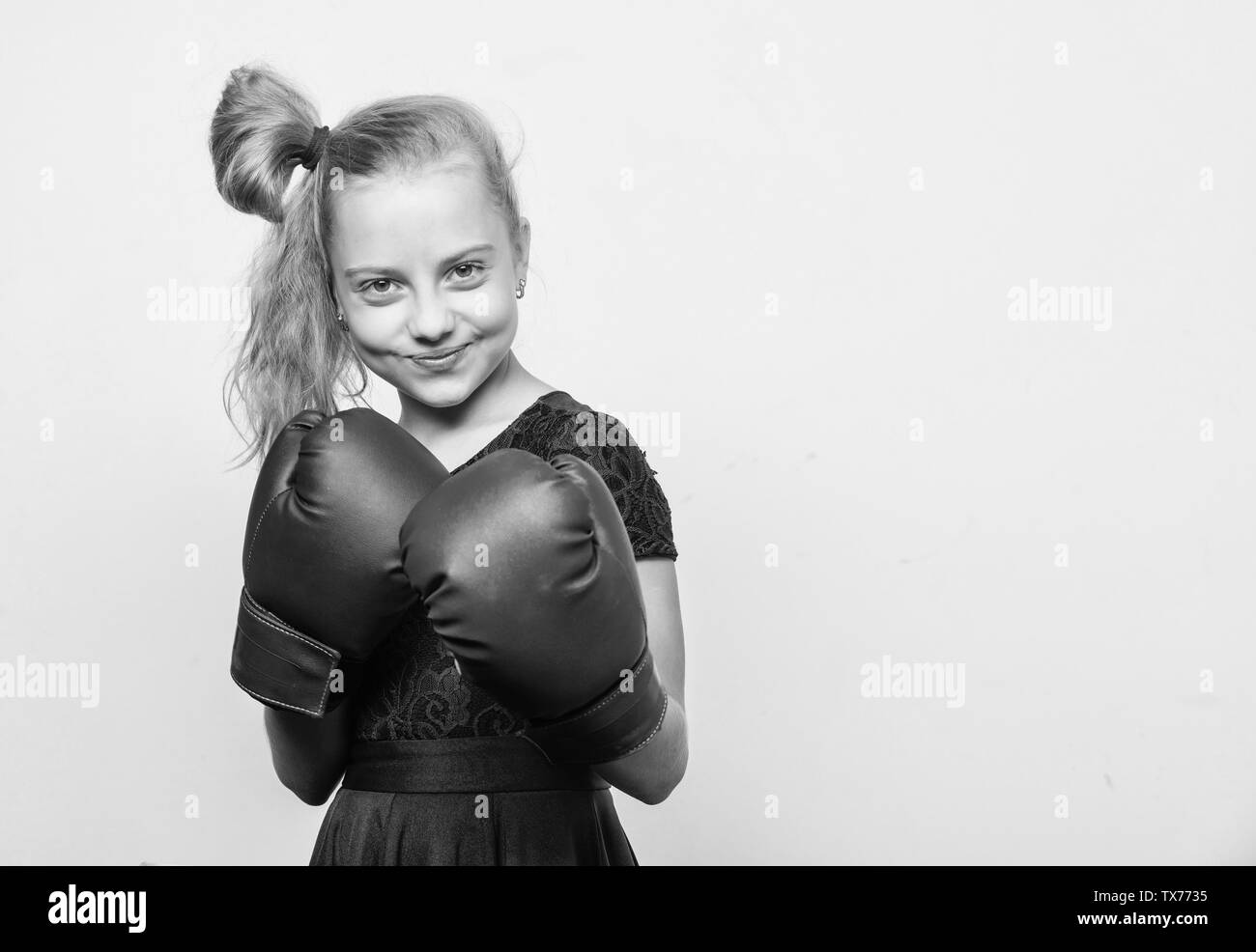 little girl in boxing gloves punching. knockout and energy. Sport success. training with coach. Fight. Boxer child workout, healthy fitness. Sport and sportswear fashion, copy space. Ready to fight. - Stock Image