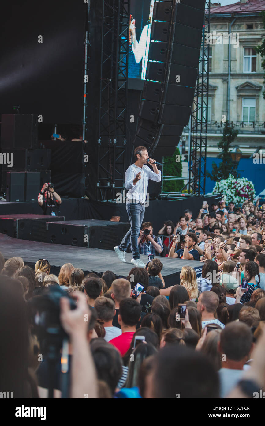LVIV, UKRAINE - June 18, 2019: Vakarchuk at stage talking in microphone. political - Stock Image