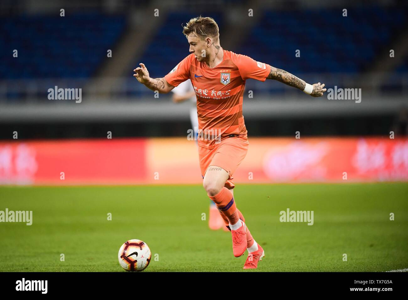 Brazilian football player Roger Krug Guedes, known as Roger Guedes of Shandong Luneng Taishan dribbles against Tianjin TEDA in their 14th round match during the 2019 Chinese Football Association Super League (CSL) in Tianjin, China, 22 June 2019. Tianjin TEDA defeated Shandong Luneng Taishan 2-0. Stock Photo