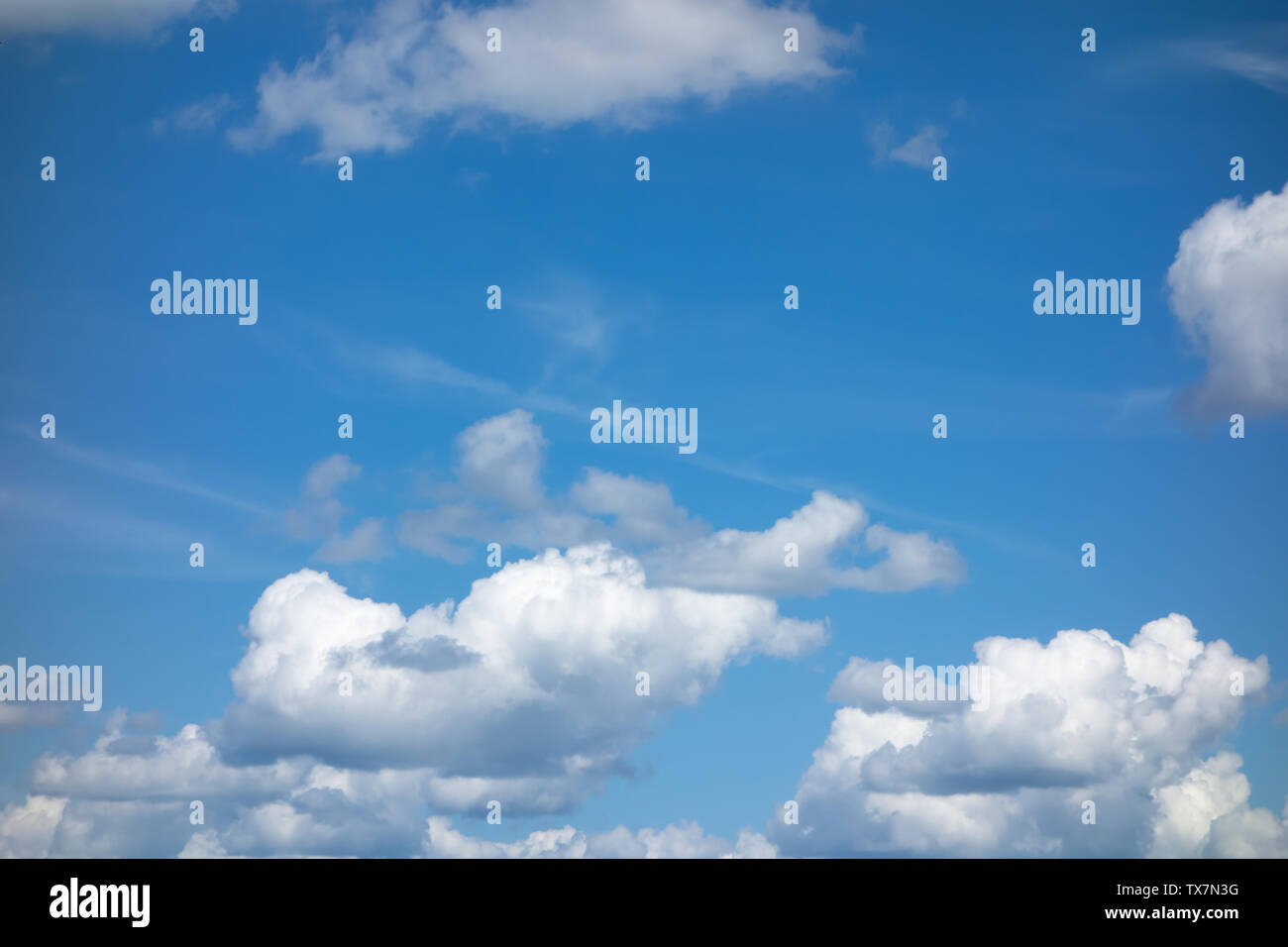 blue sky with flying white light clouds - Stock Image