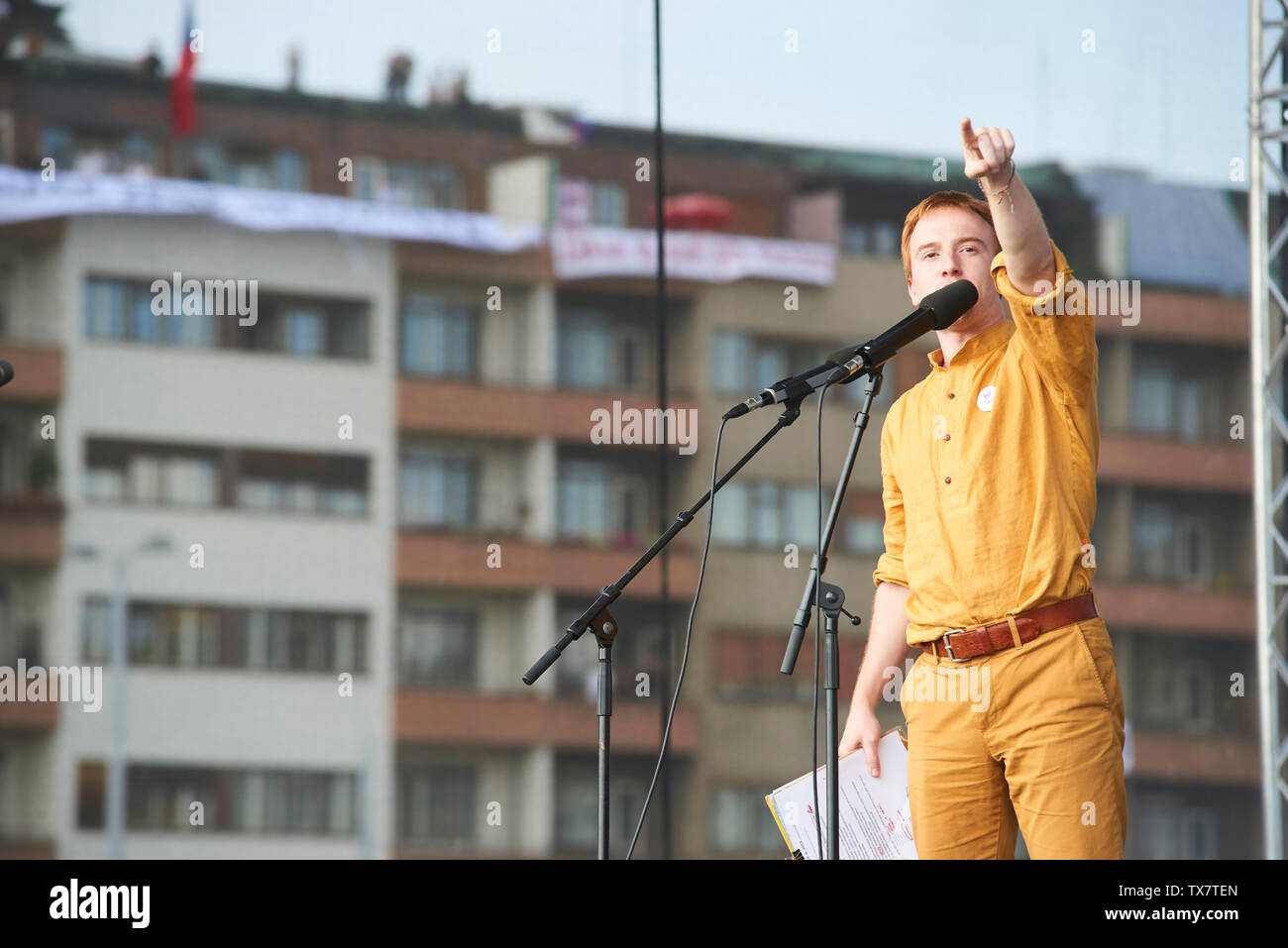 Prague/ Czech Republic - June 23 2019: Mikulas Minar - activist and leader speaks to protesters. Crowd of people protests against Prime Minister Babis - Stock Image