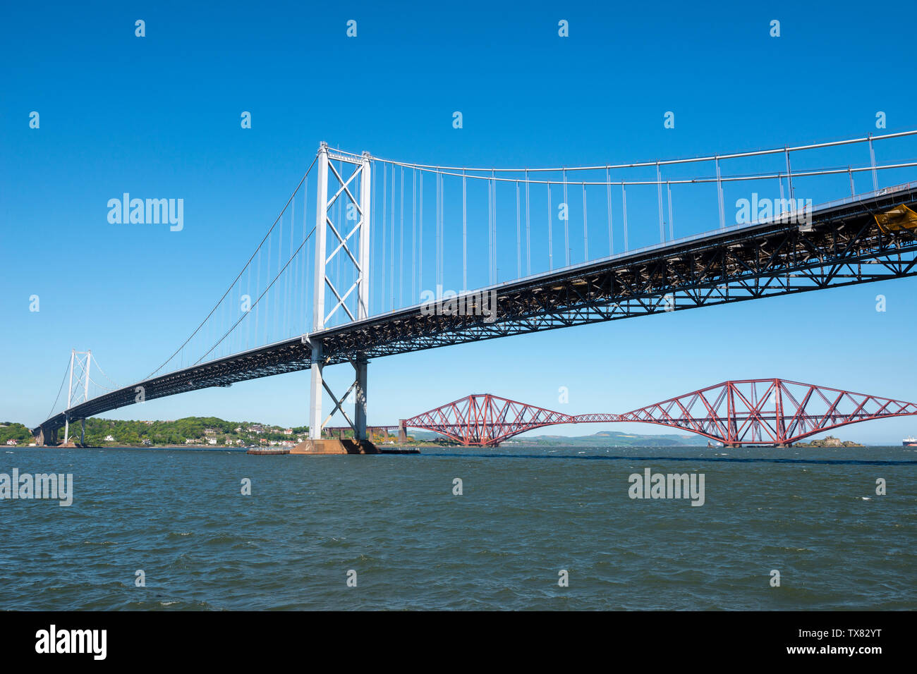 Forth Road Bridge and Forth Railway Bridge spanning River Forth viewed from Port Edgar, Queensferry, Scotland, UK Stock Photo