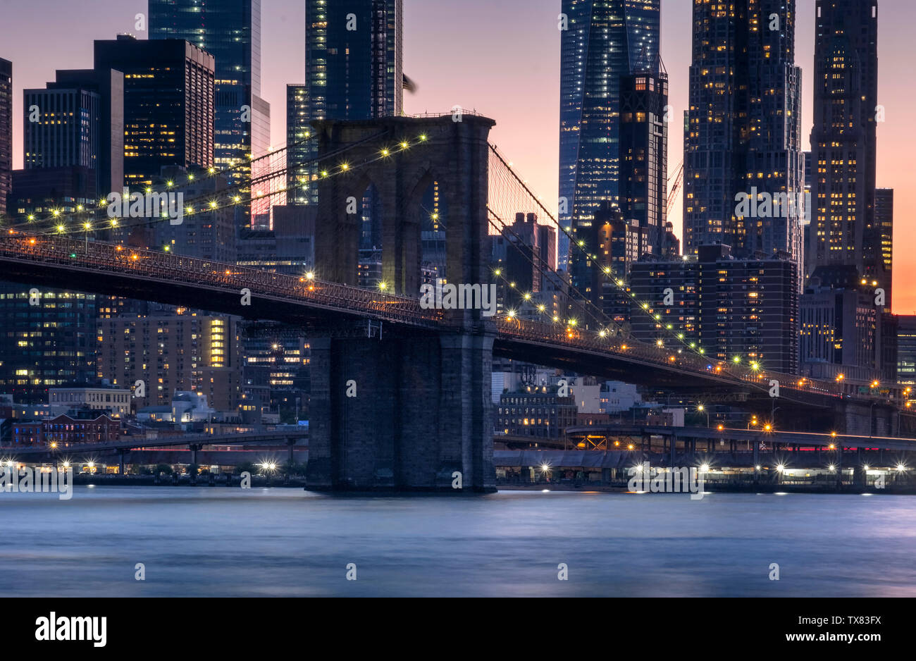 The Brooklyn Bridge over the East River at sunset, New York, USA Stock Photo