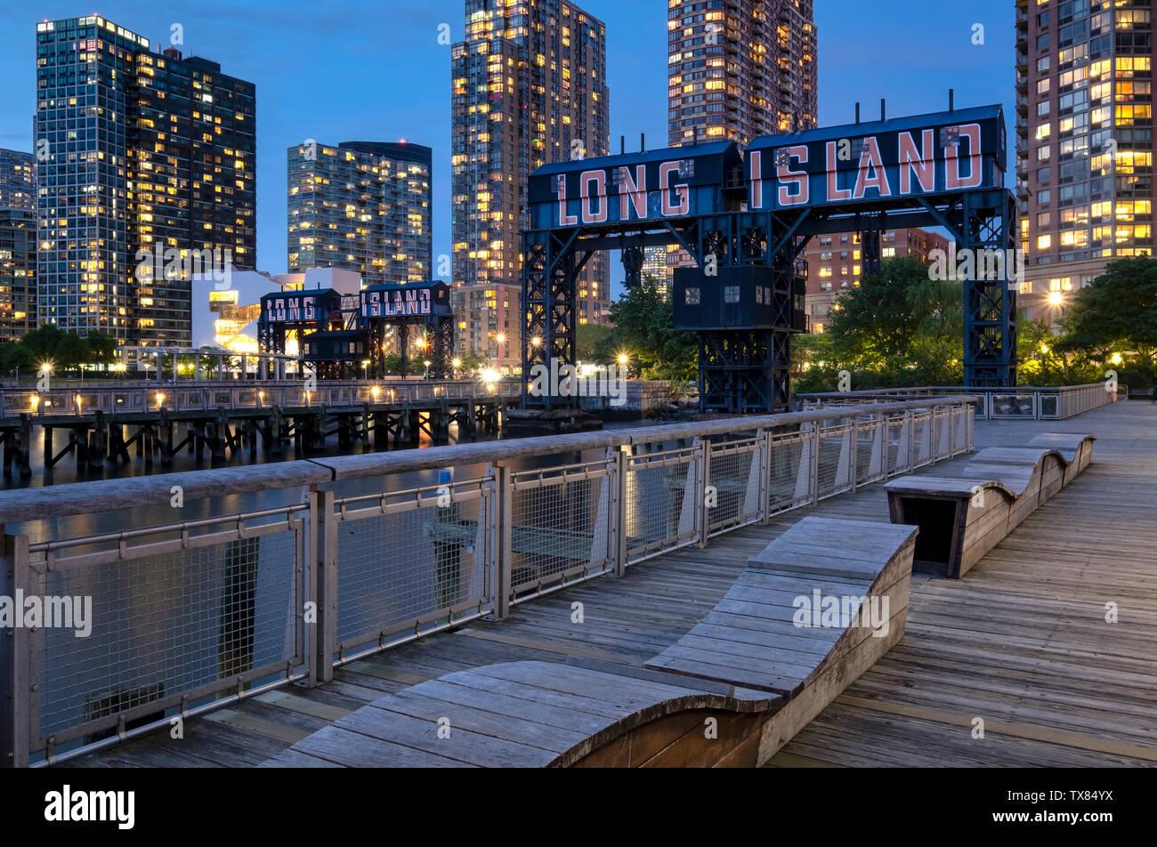 Gantry Plaza State Park at night with Long Island restored Gantries, Long Island City, New York, USA Stock Photo