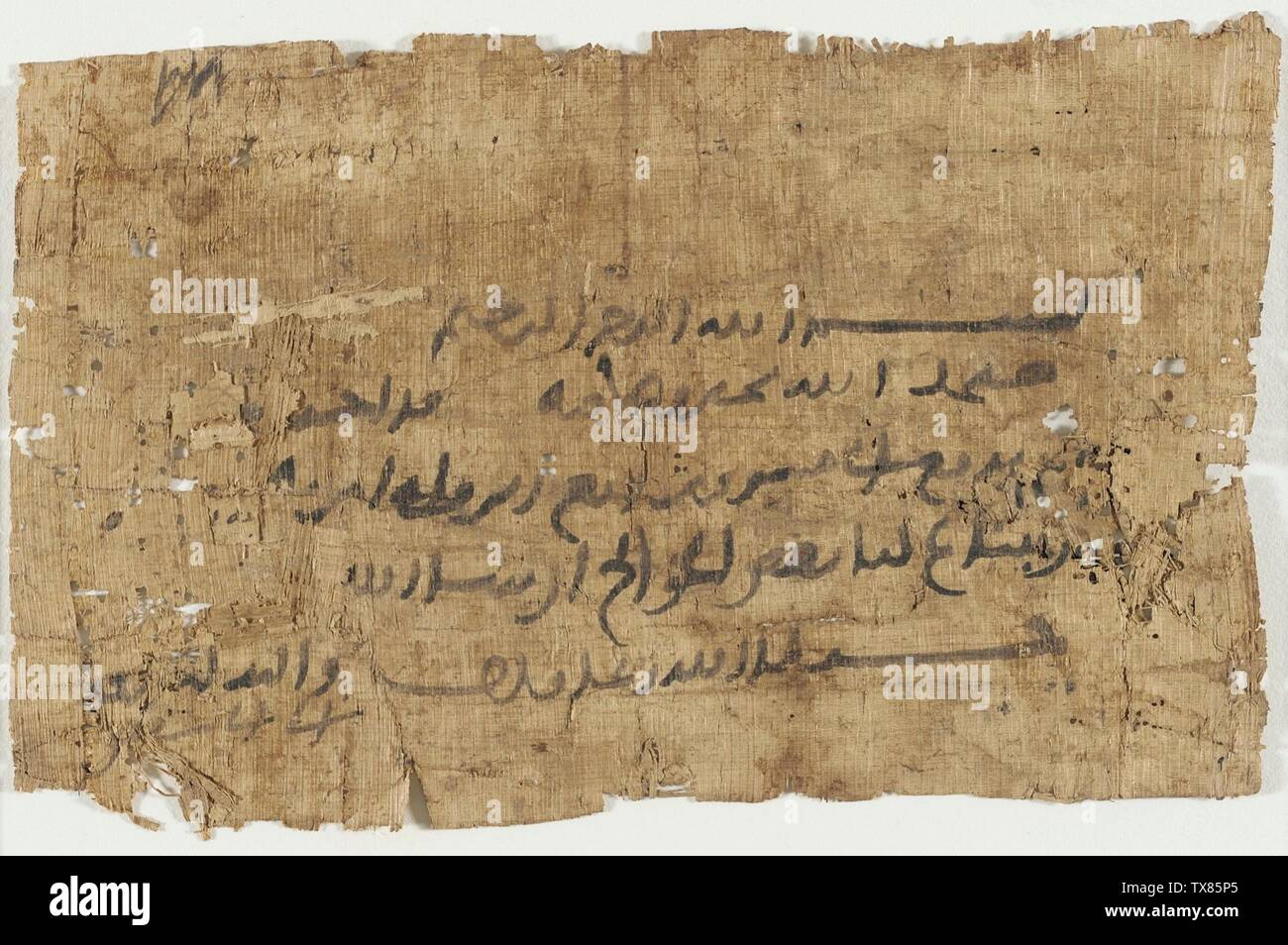 'Letter; English:  Egypt, 7th-9th century Books Ink on papyrus 5 1/4 x 8 1/4 in. (13.33 x 20.95 cm); Mount:  14 1/4 x 19 1/4 in. (36.19 x 48.89 cm) The Madina Collection of Islamic Art, gift of Camilla Chandler Frost (M.2002.1.366) Islamic Art; 7th-9th century; ' - Stock Image