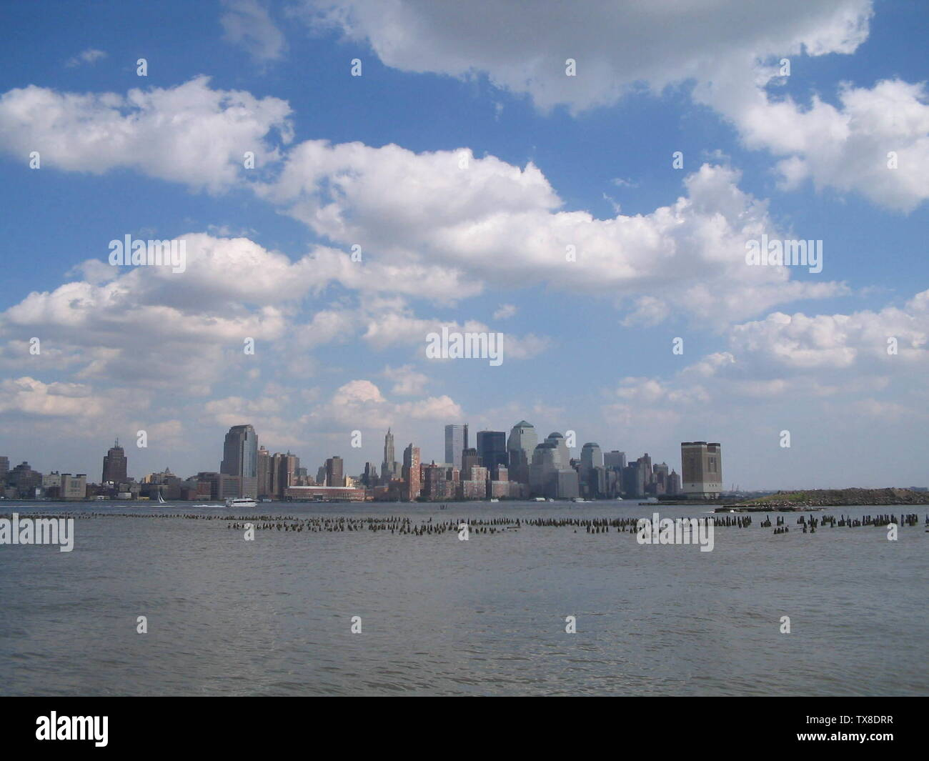 """English: The Lower Manhattan skyline as viewed from Hoboken.  The brick structure rising out of the Hudson River is a ventilation structure for the Holland Tunnel. Photo by Matthew Jesuele.; 18 June 2005 (original upload date); Transferred from en.wikipedia to Commons by Premeditated Chaos using CommonsHelper.; Vladtheinhaler at English Wikipedia; "" Stock Photo"