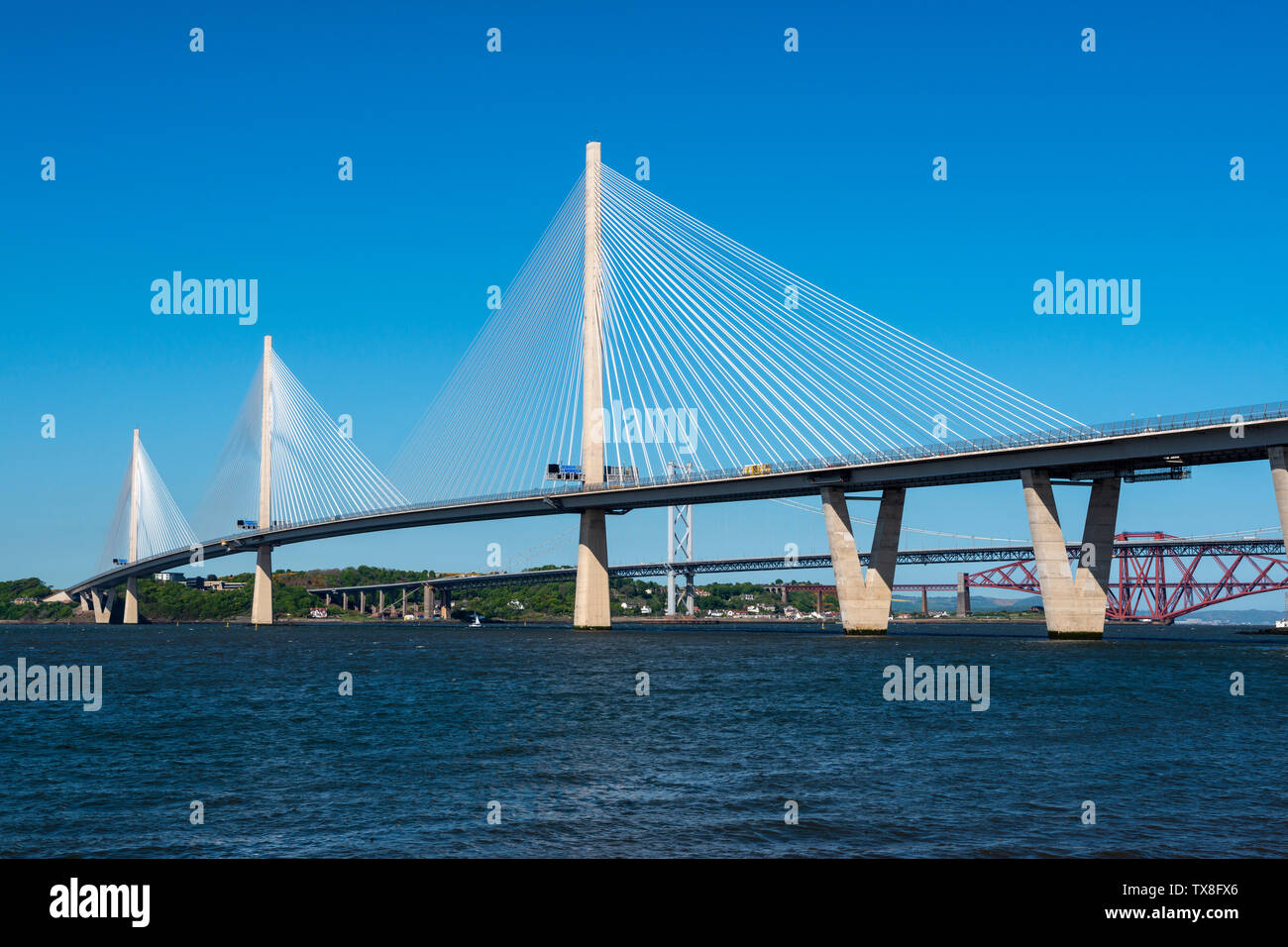 New Queensferry Crossing road bridge, with Forth Road Bridge and Forth Railway Bridge in background, viewed from South Queensferry, Scotland, UK Stock Photo