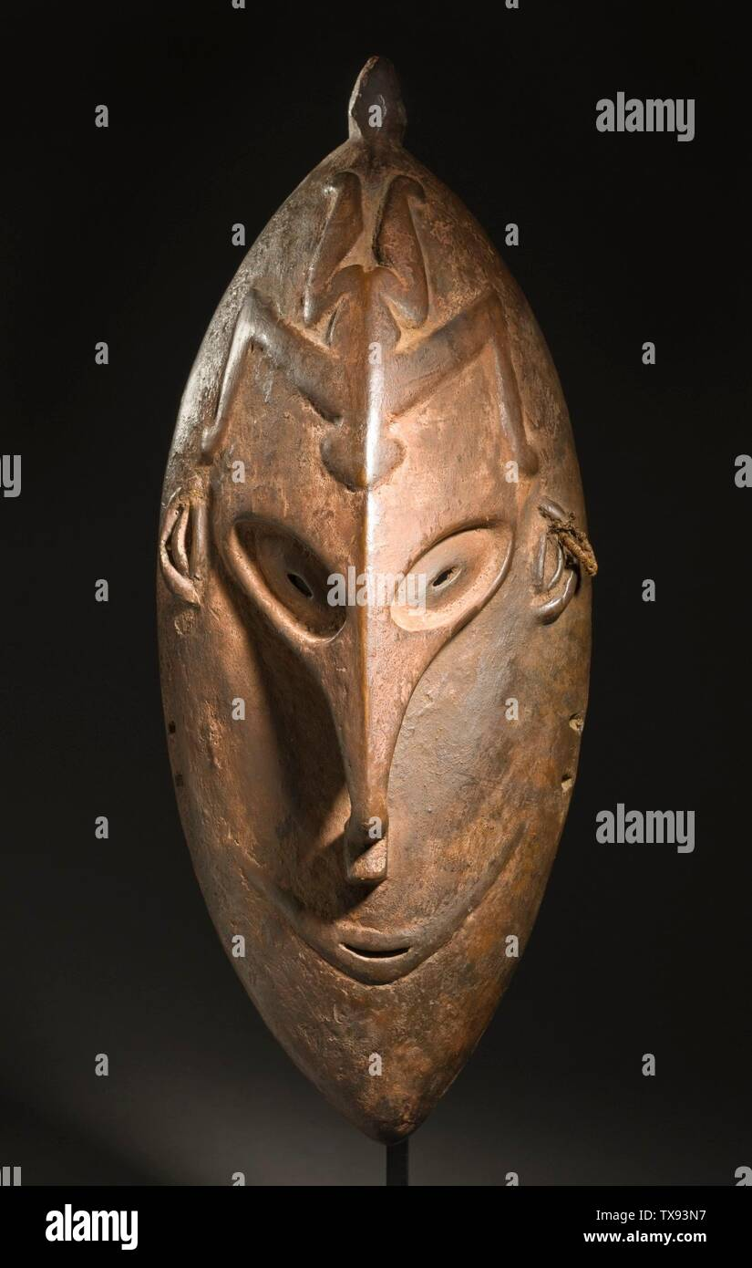 """""""Mask; English:  Papua New Guinea, East Sepik Province, Lower Sepik River, Coastal Zone, circa 1909 Jewelry and Adornments; masks Wood and traces of pigment 15 1/2 x 6 1/4 x 4 in. (39.37 x 15.88 x 10.16 cm) Purchased with funds provided by the Eli and Edythe Broad Foundation with additional funding by Jane and Terry Semel, the David Bohnett Foundation, Camilla Chandler Frost, Gayle and Edward P. Roski and The Ahmanson Foundation (M.2008.66.28) Art of the Pacific Currently on public view: Ahmanson Building, floor 1; circa 1909 date QS:P571,+1909-00-00T00:00:00Z/9,P1480,Q5727902; """" Stock Photo"""