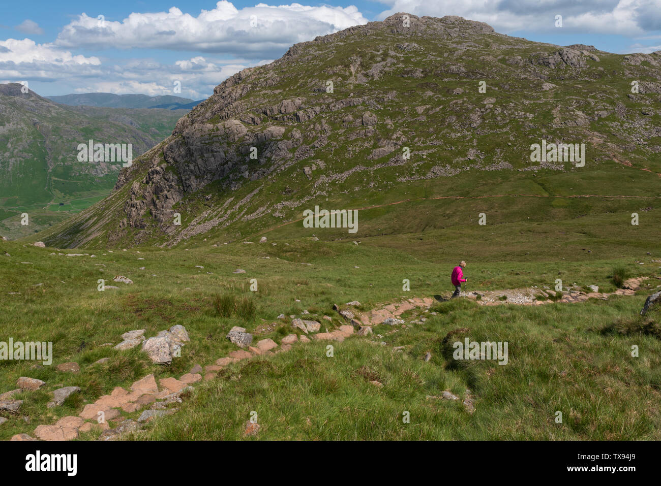 The descent to red Tarn from Crinkle Crags in Cumbria Stock Photo