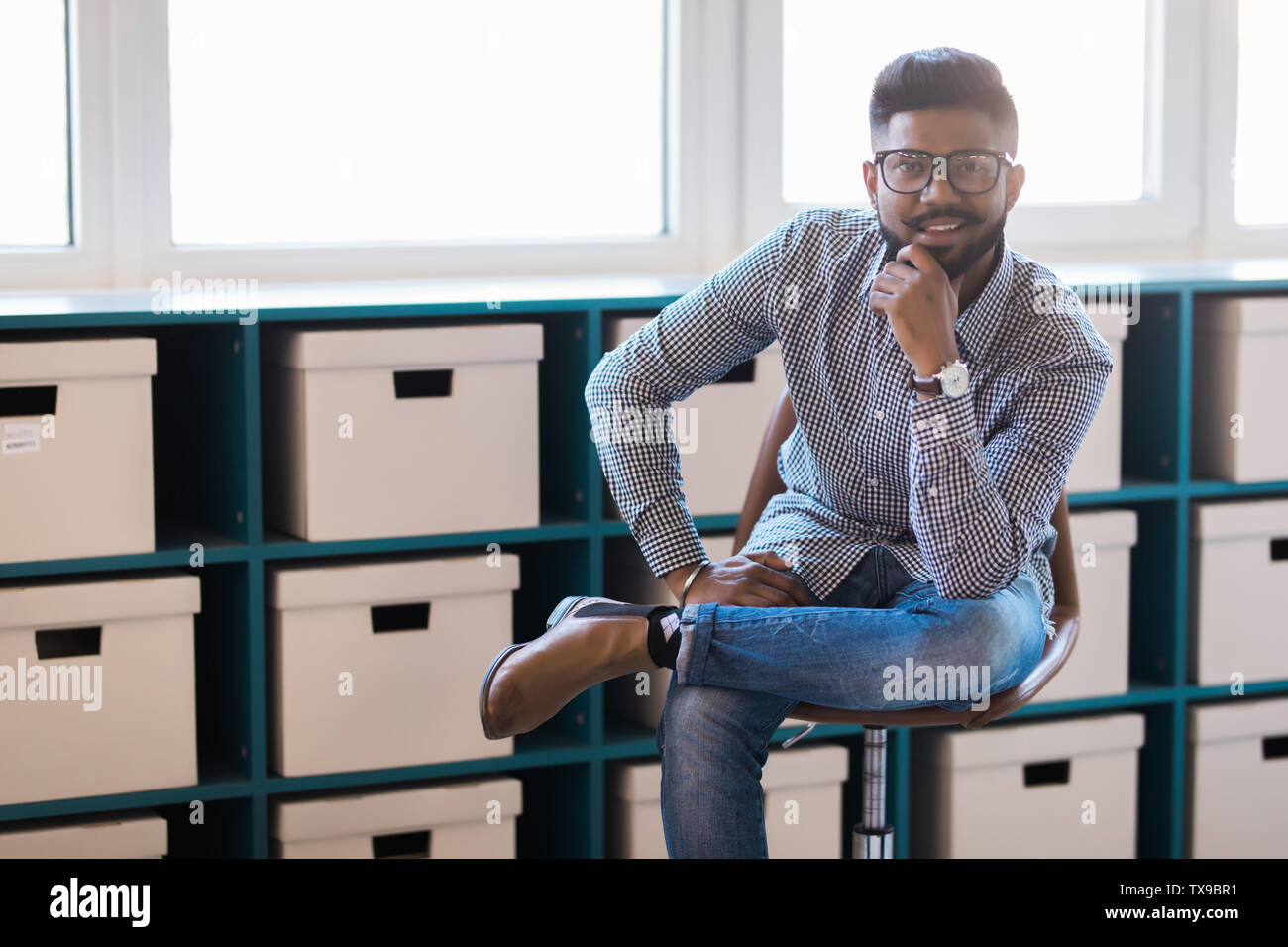 Fabulous Young Indian Man Sitting In Chair In His Modern Office Pdpeps Interior Chair Design Pdpepsorg