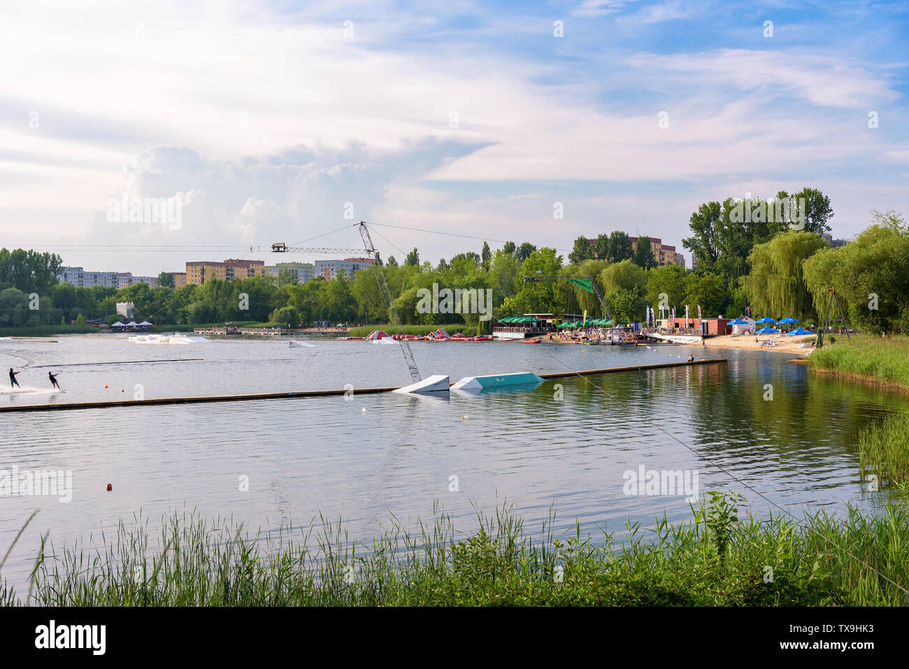 Sosnowiec, Poland - June 19, 2019: People use wakeboard on Wake Zone Stawiki water park Stock Photo