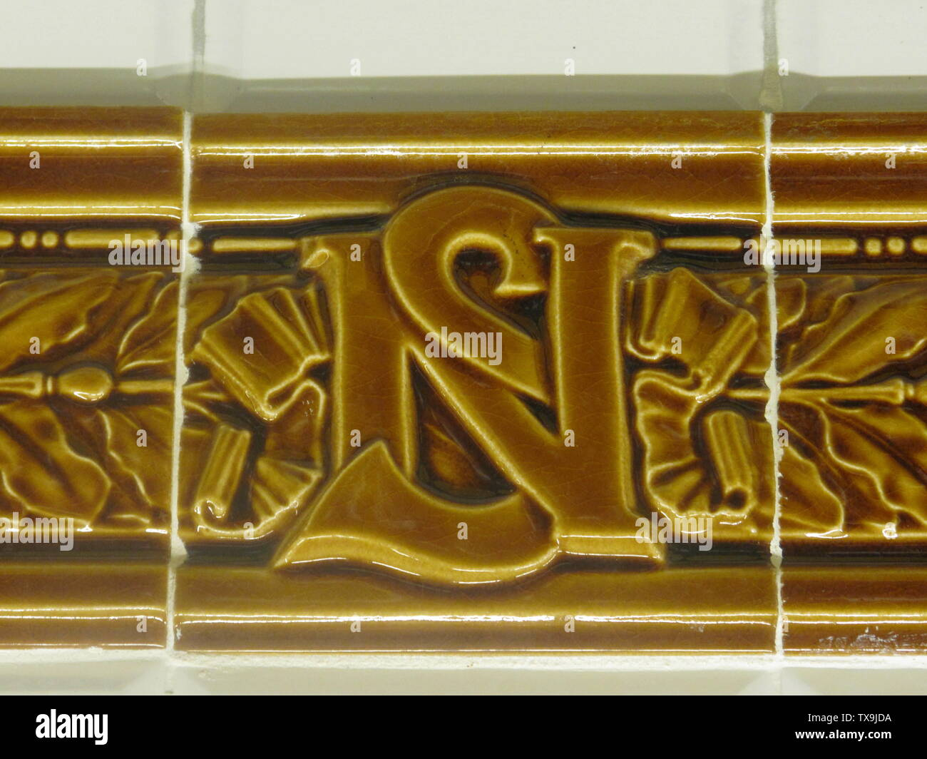 'English: Monogram NS that we found all along the frames around the names of the station of the former metro company Nord-Sud (=North-South) Français: Monogramme NS que l'on trouve à intervalles réguliers sur les cadres des noms de station de l'ancienne compagnie Nord-Sud.; 23 April 2010; Own work; Tangopaso; ' - Stock Image