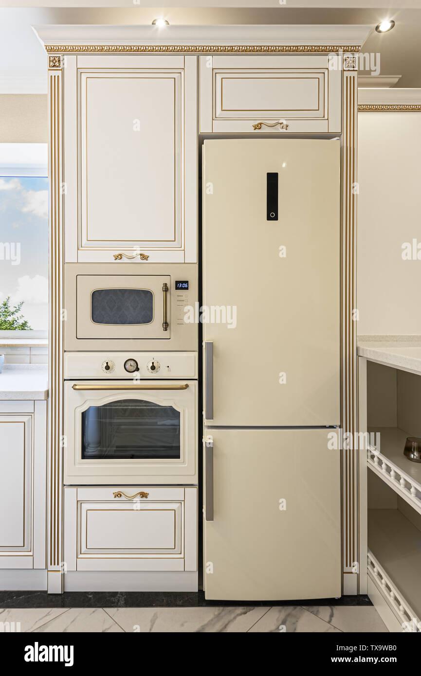 neoclassic style luxury kitchen interior with island - Stock Image