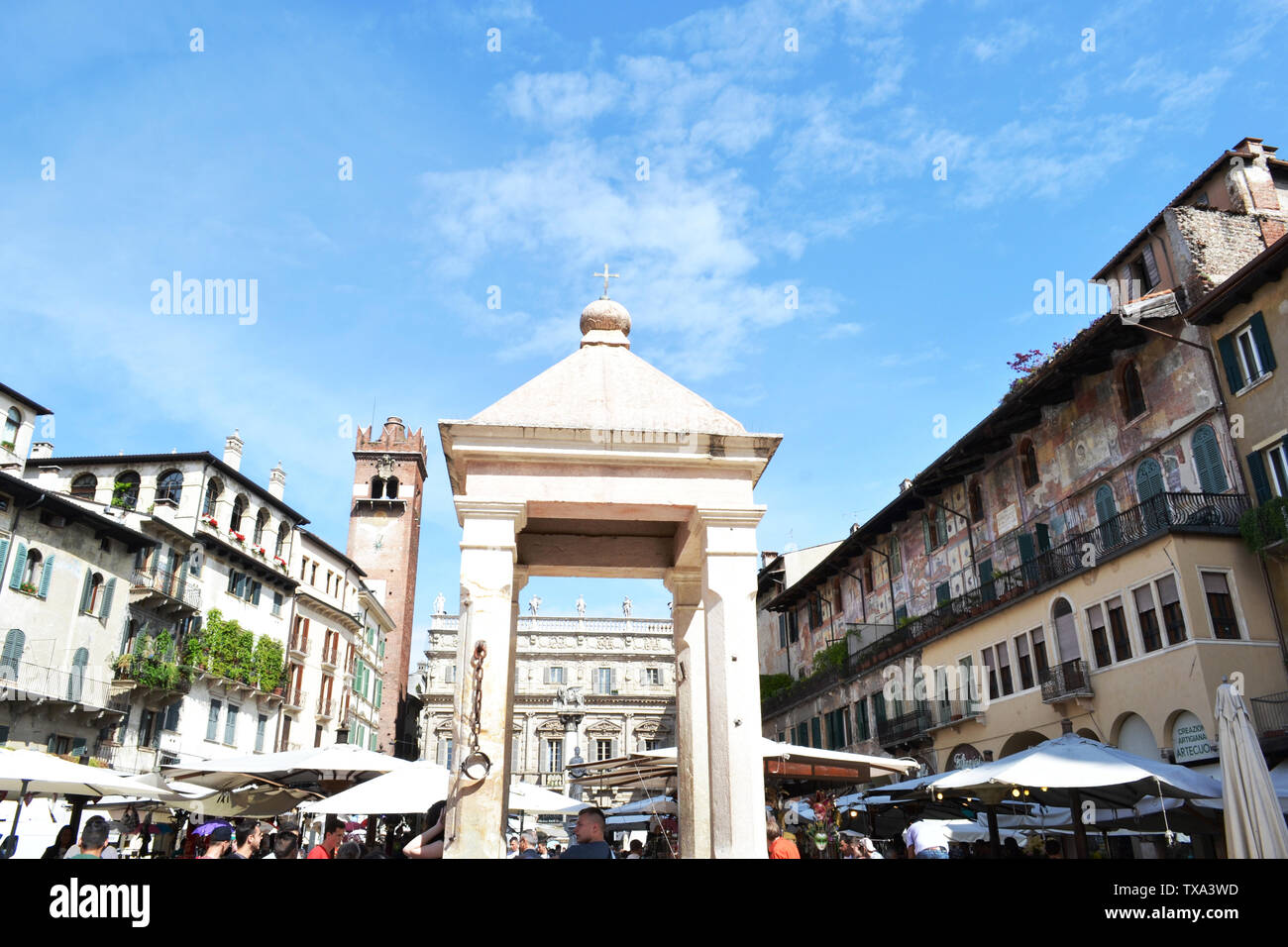 Verona/Italy - May 9, 2015: Architecture of Piazza delle Erbe in Verona during traditional fruit and vegetable market hours. Stock Photo