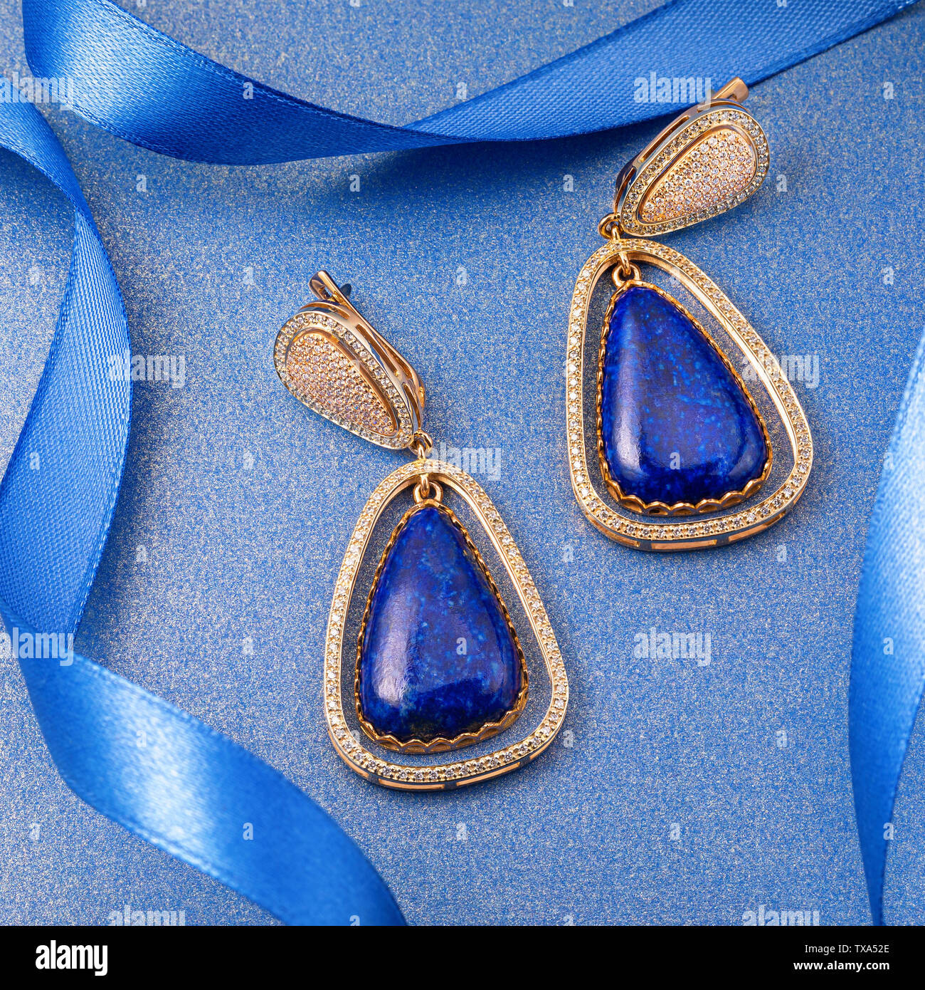 Beautiful gold earrings with precious stones Stock Photo