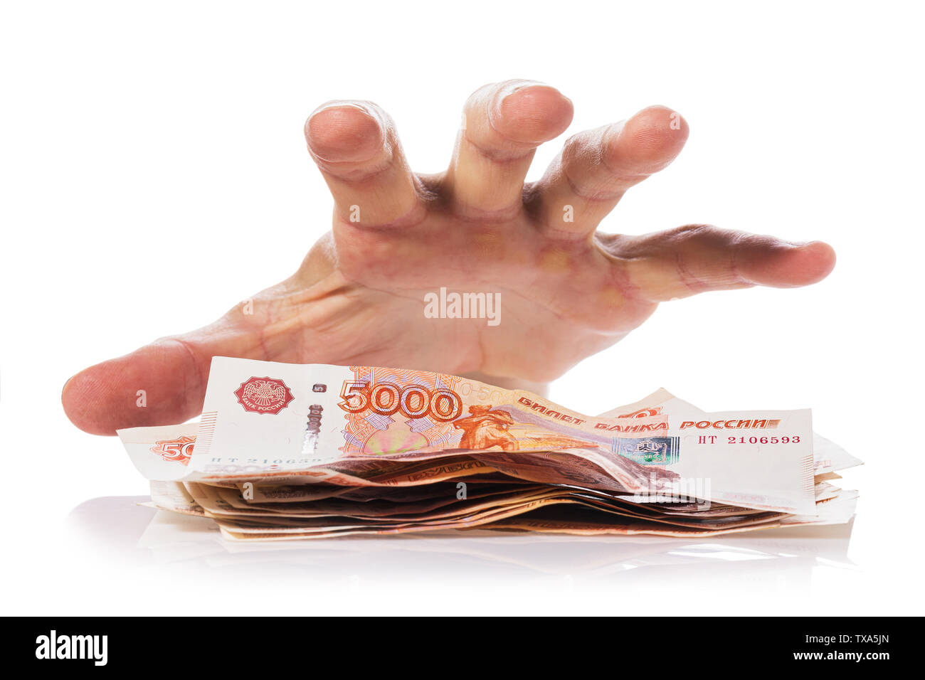 Hand about to grab the money, Isolated on white background. Concept on theft or fraud with currency - Stock Image