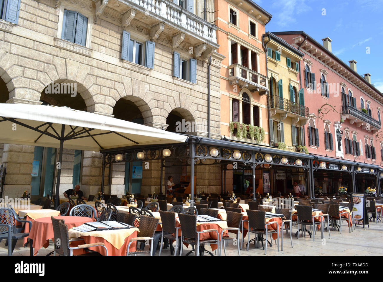 Verona/Italy - May 9, 2015: Restaurants and cafes of the Piazza delle Erbe in Verona. Stock Photo
